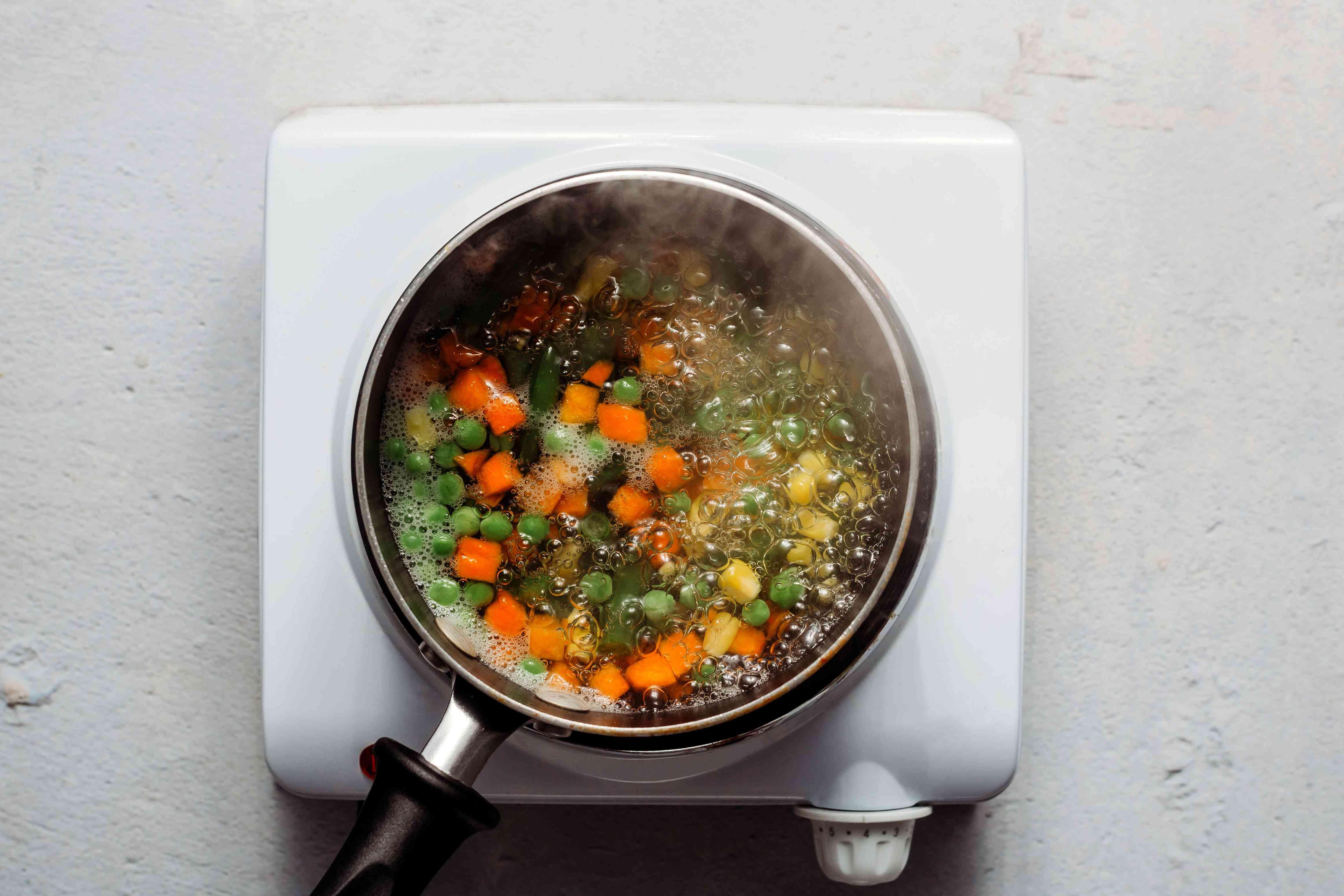 boil vegetables in a pot