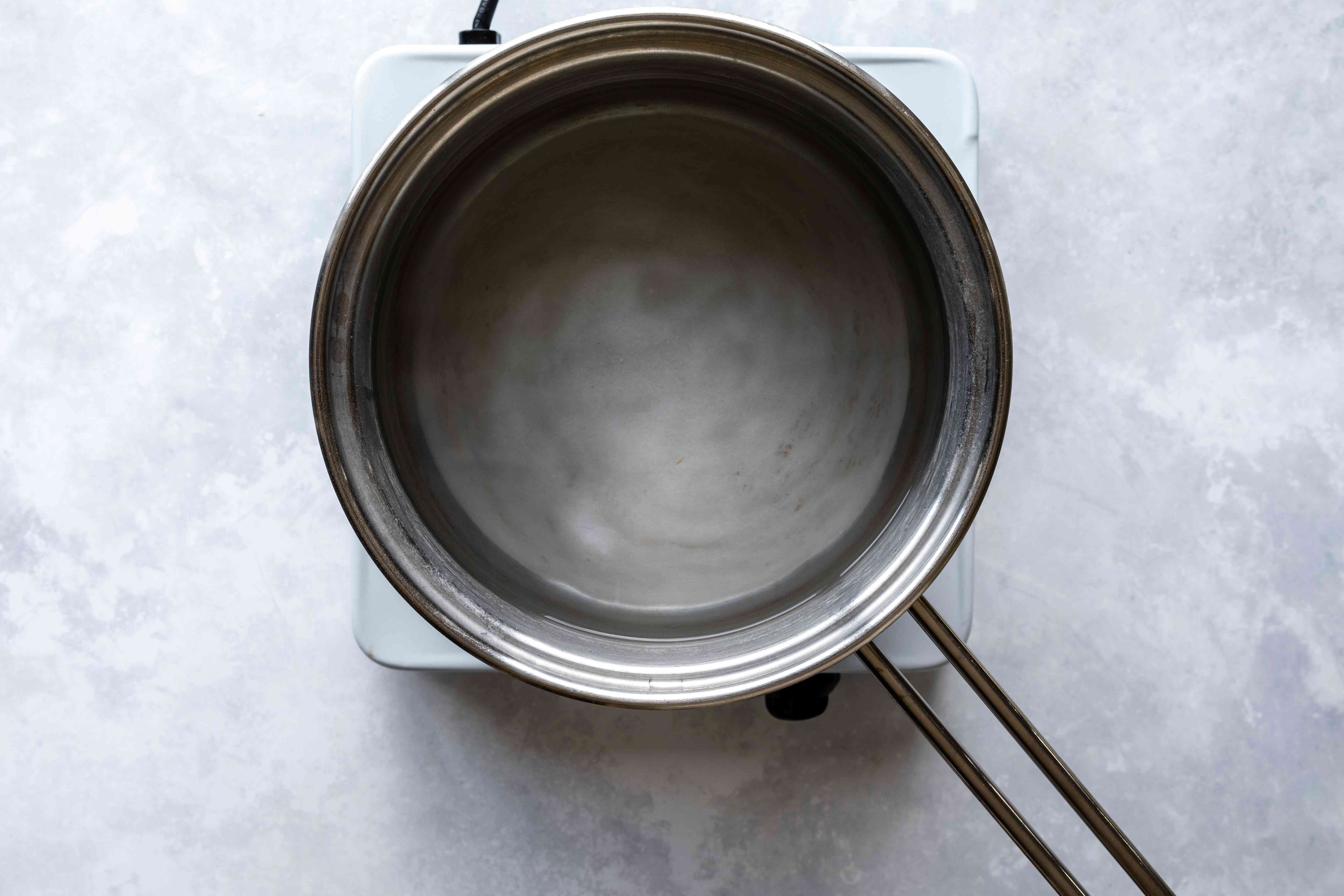 Bring water and baking soda to a boil