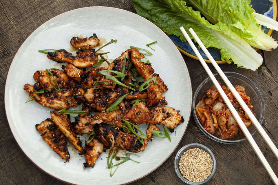 charcoal grilled bulgogi marinated chicken with sliced scallions, kim chi, sesame seeds and lettuce
