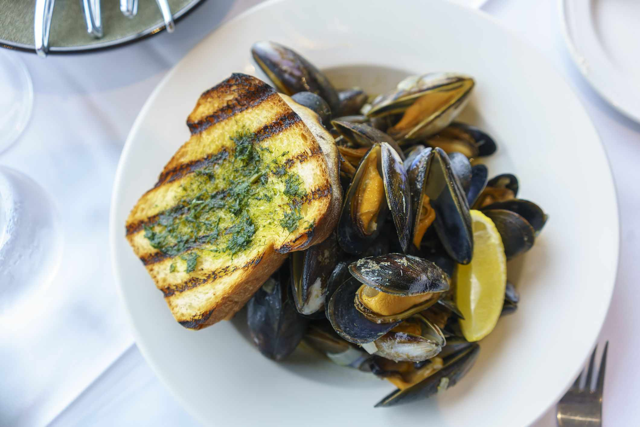 Steamed mussels in Thai basil-coconut sauce