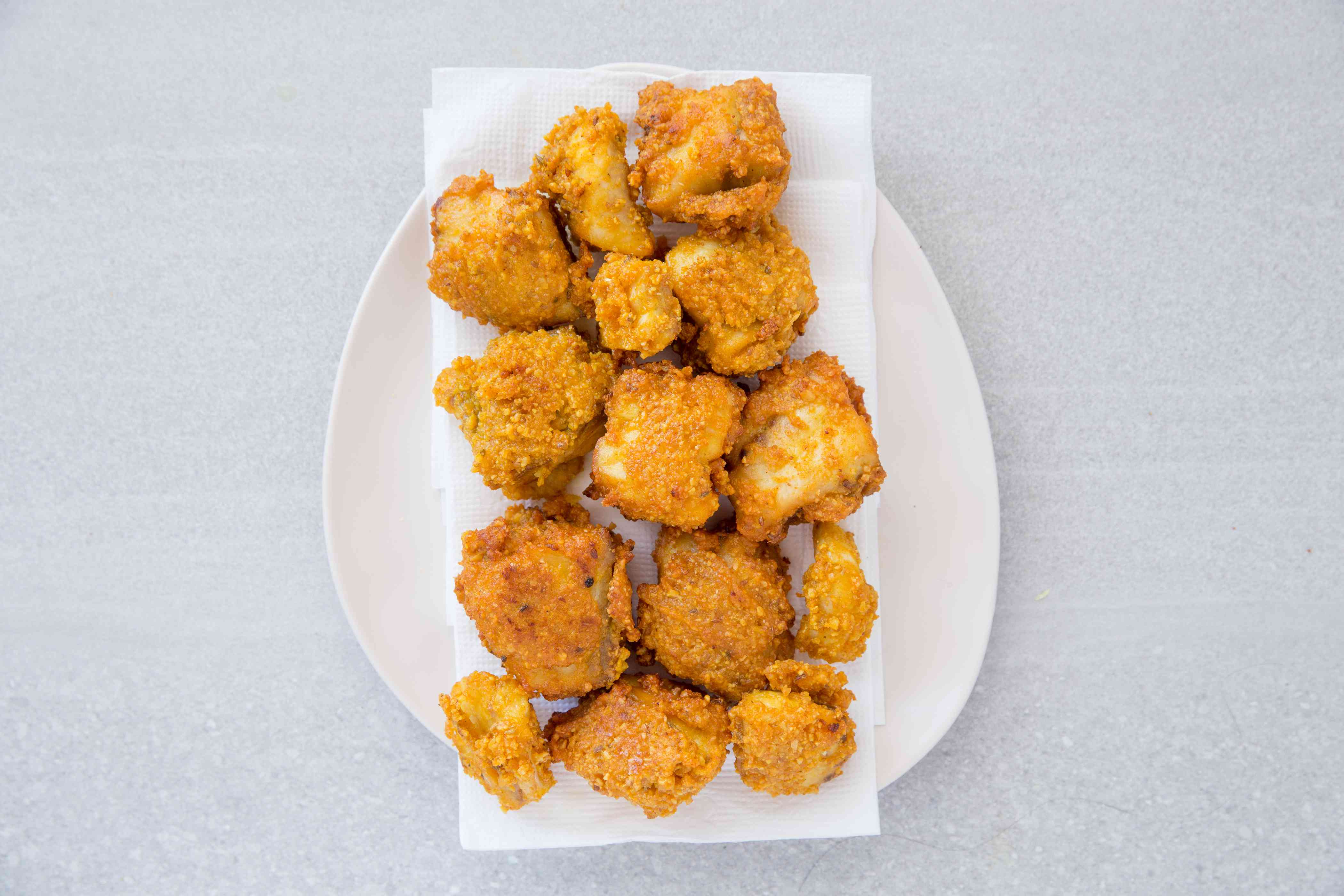 Fish Pakora on a paper towel lined plate