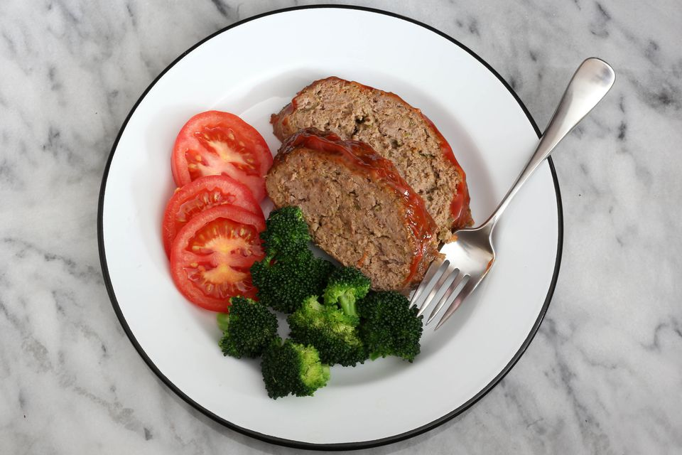 cajun meatloaf sliced on a plate