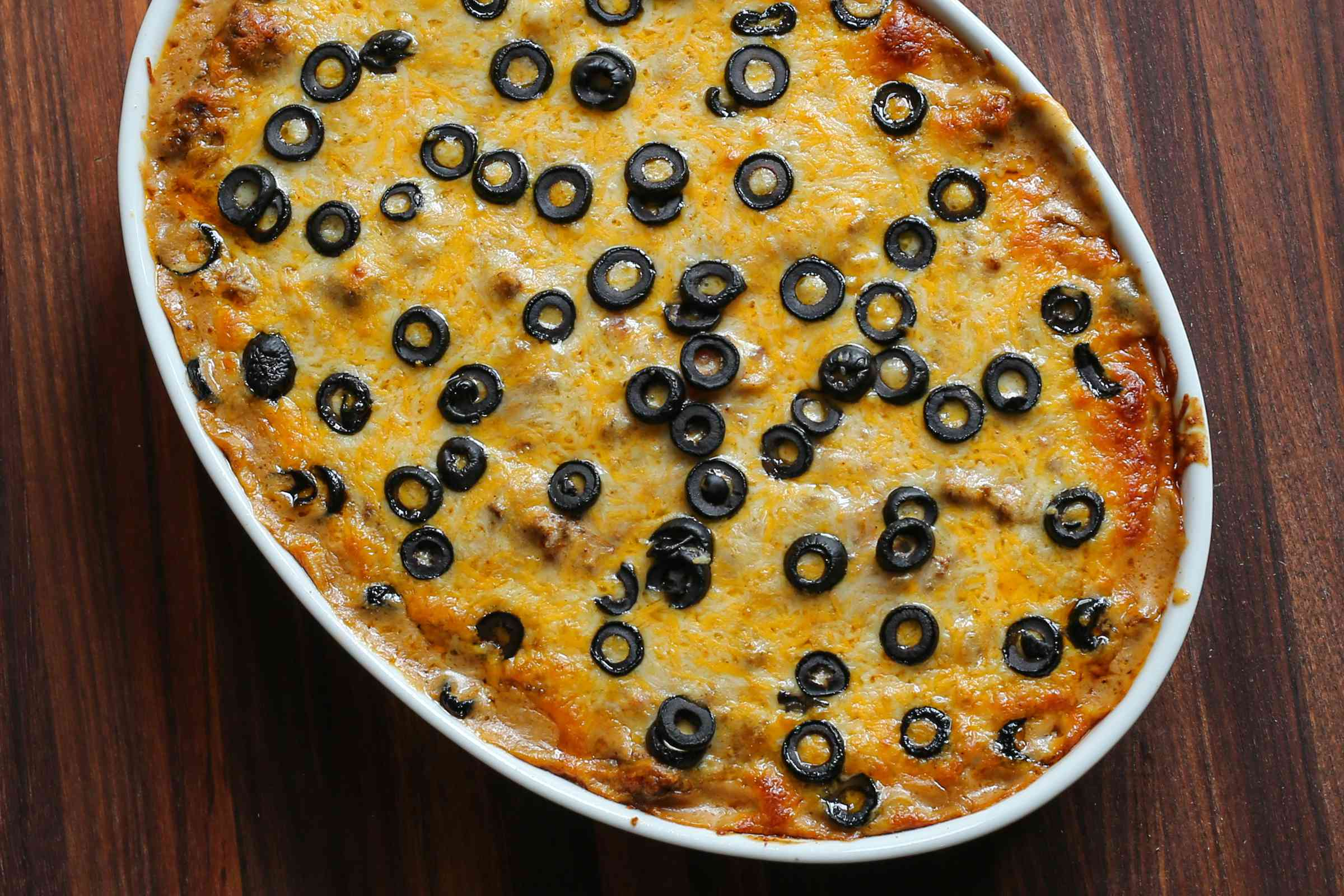 Enchilada casserole with ground beef and cheese.