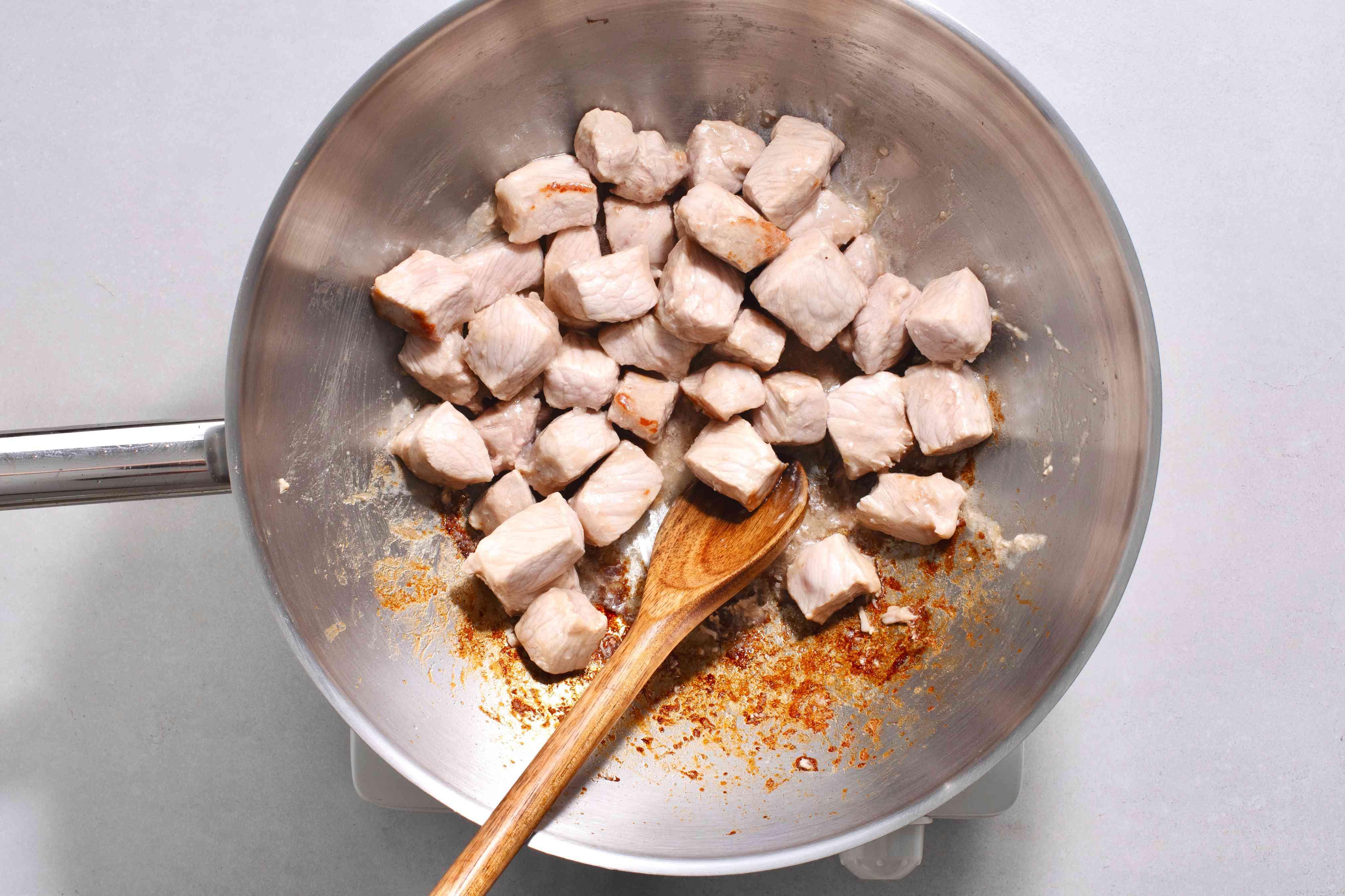 pork cooking in a wok