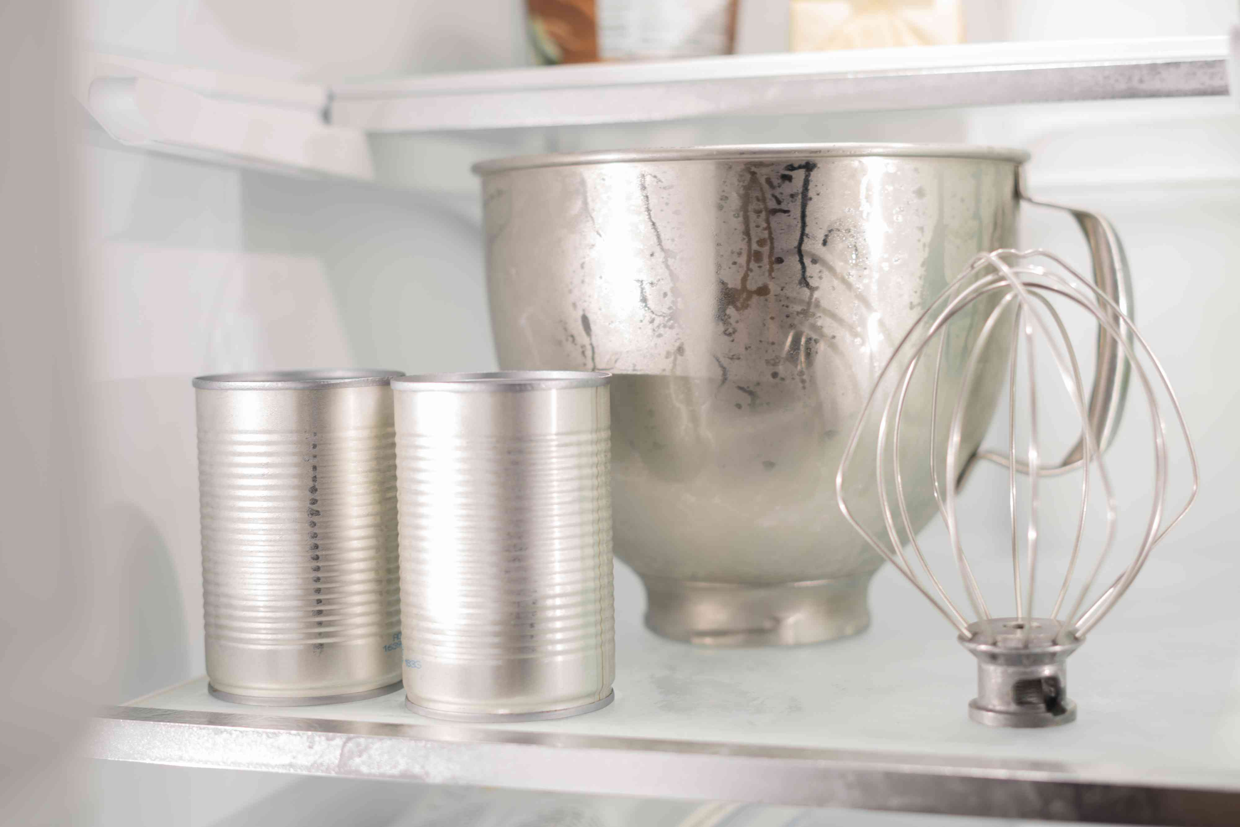 Place the canned coconut milk along with the mixing bowl into the refrigerator