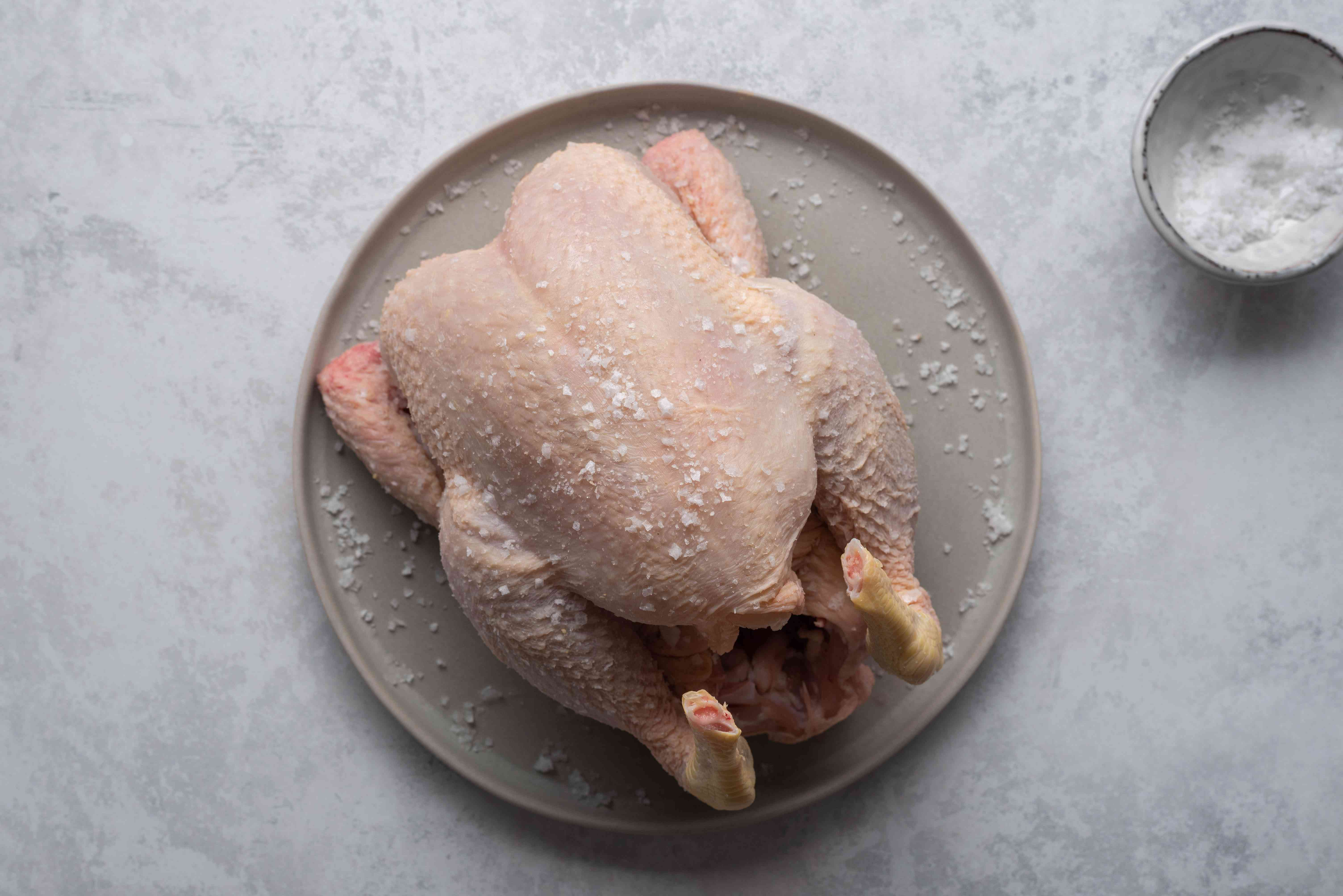 Rub chicken all over with salt