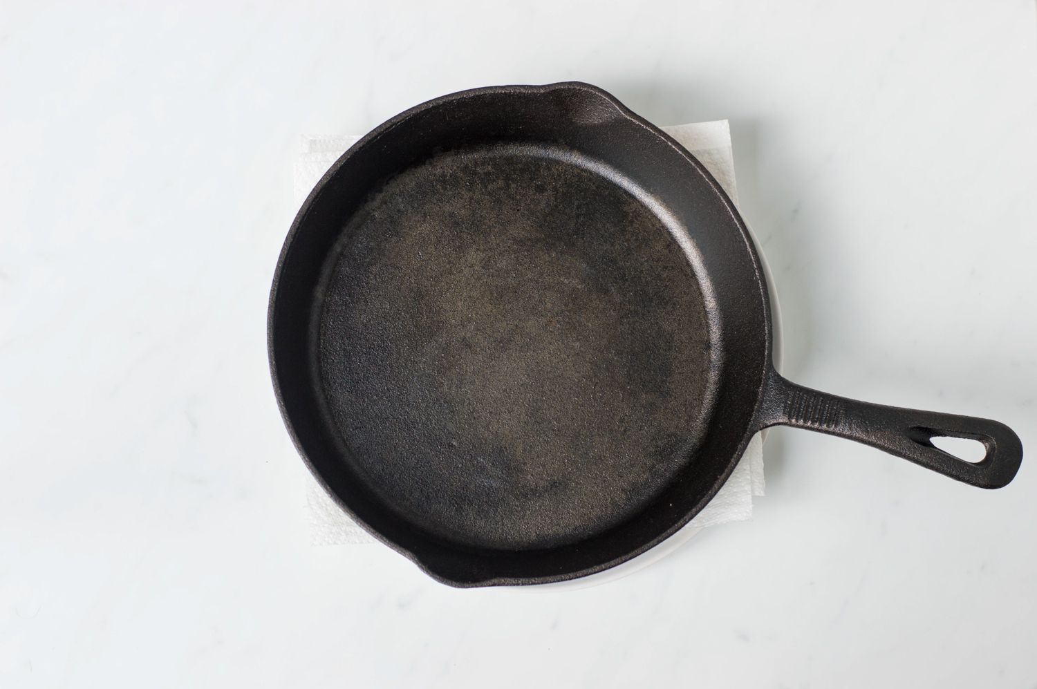 Draining tofu with iron skillet on top