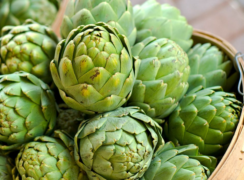 Fresh artichokes in a basket