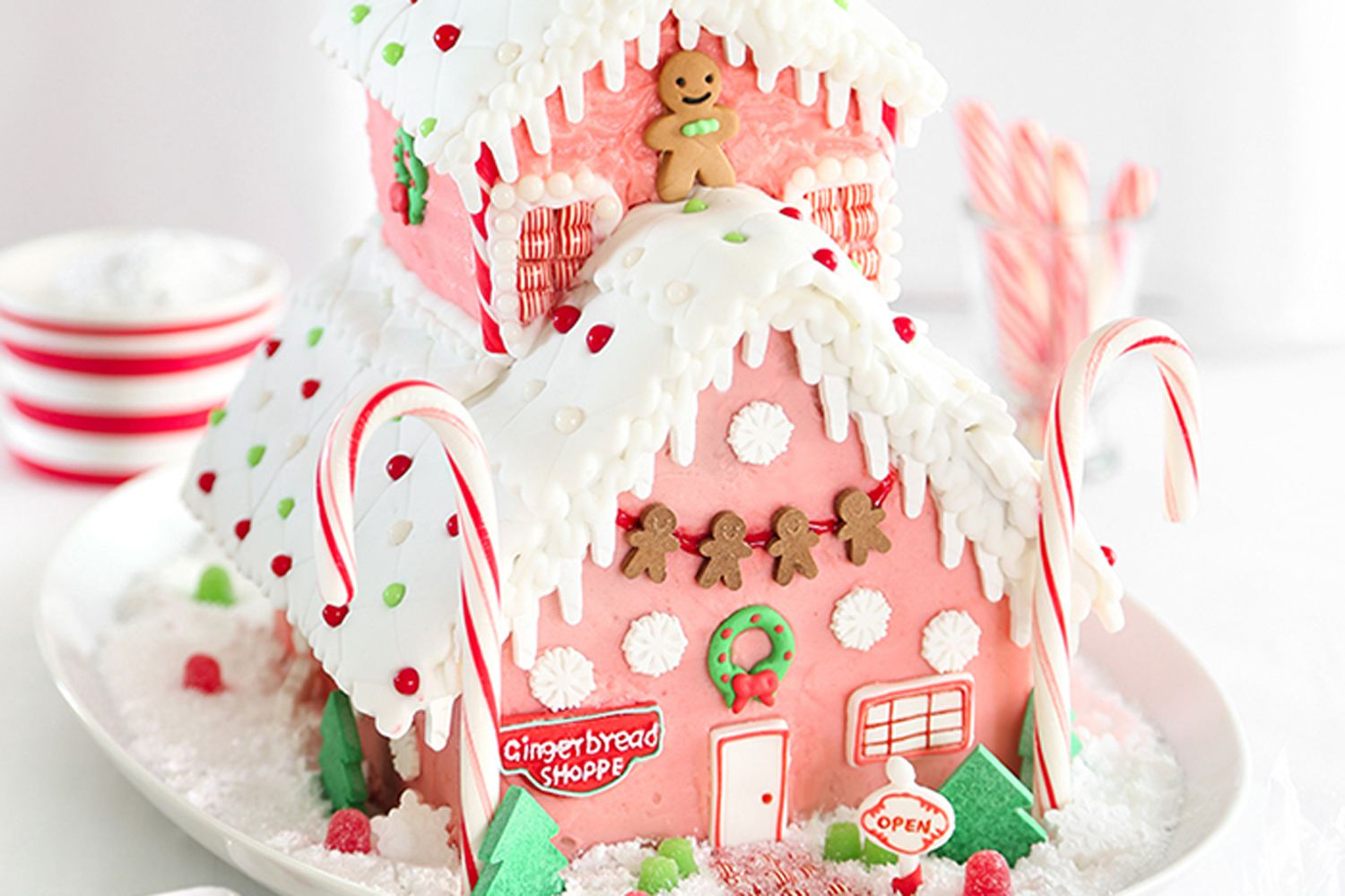 pink gingerbread house from sprinkle bakes
