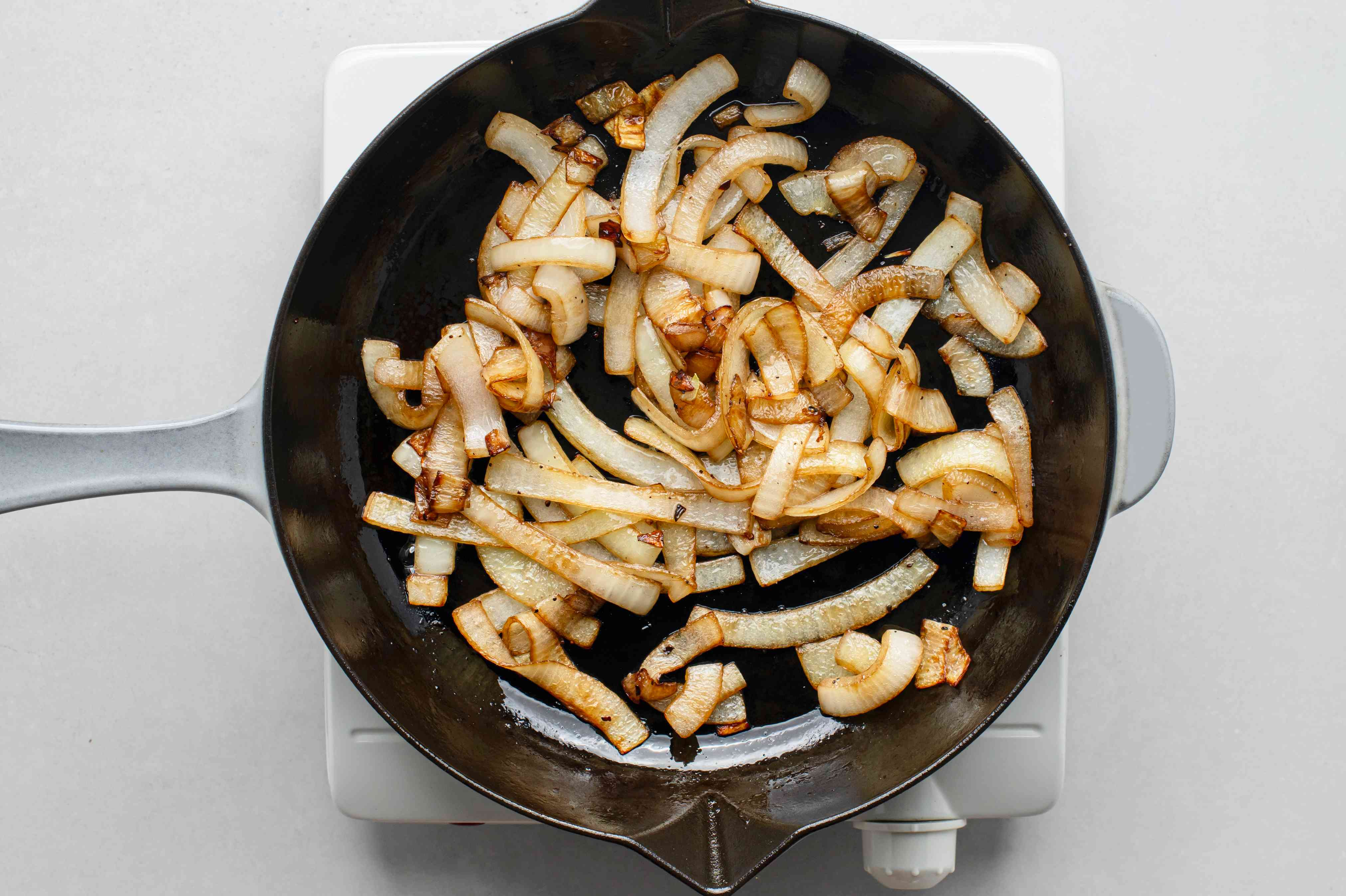 onions cooking in a skillet