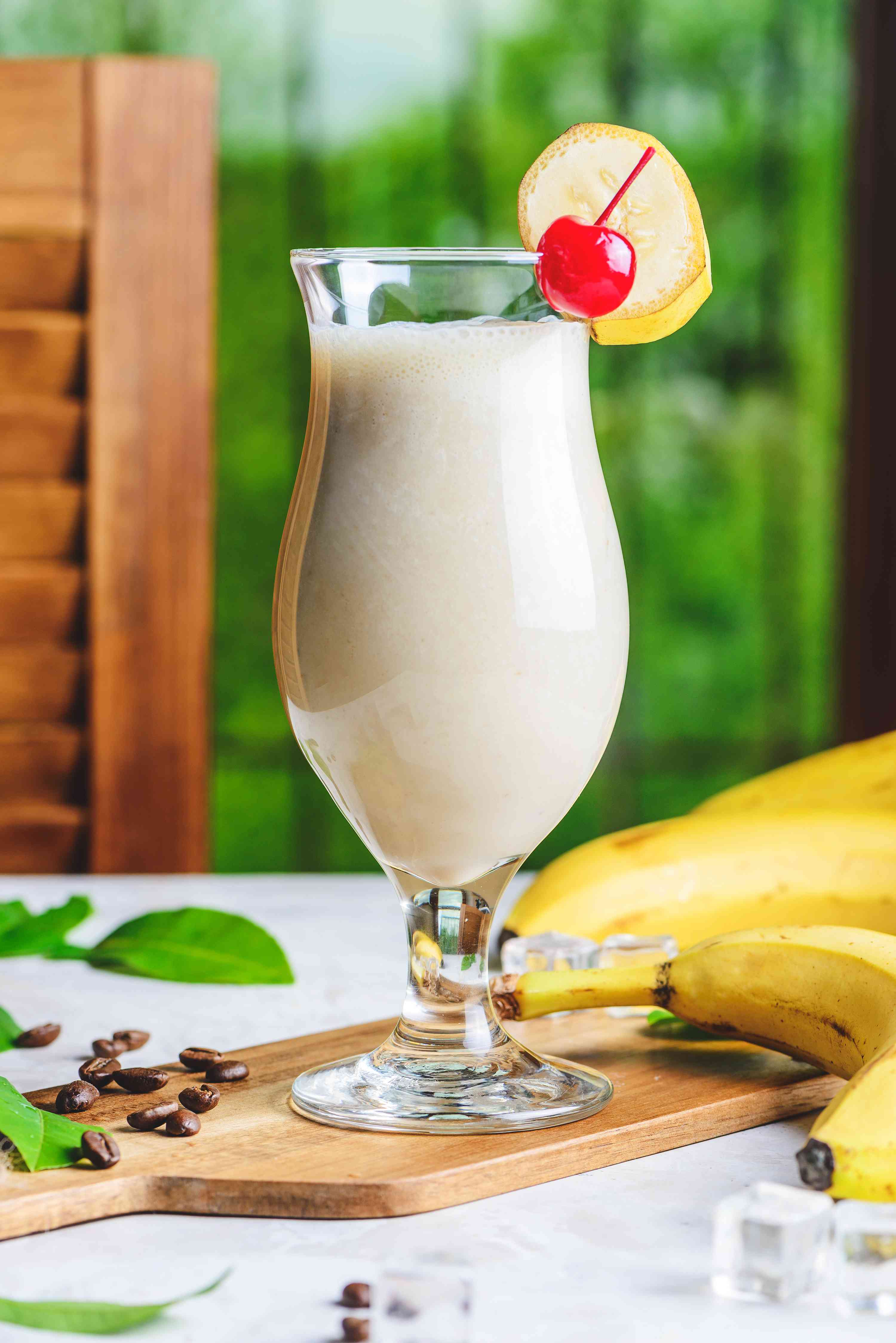 Dirty banana cocktail, ready to serve, with cherry and banana garnishes