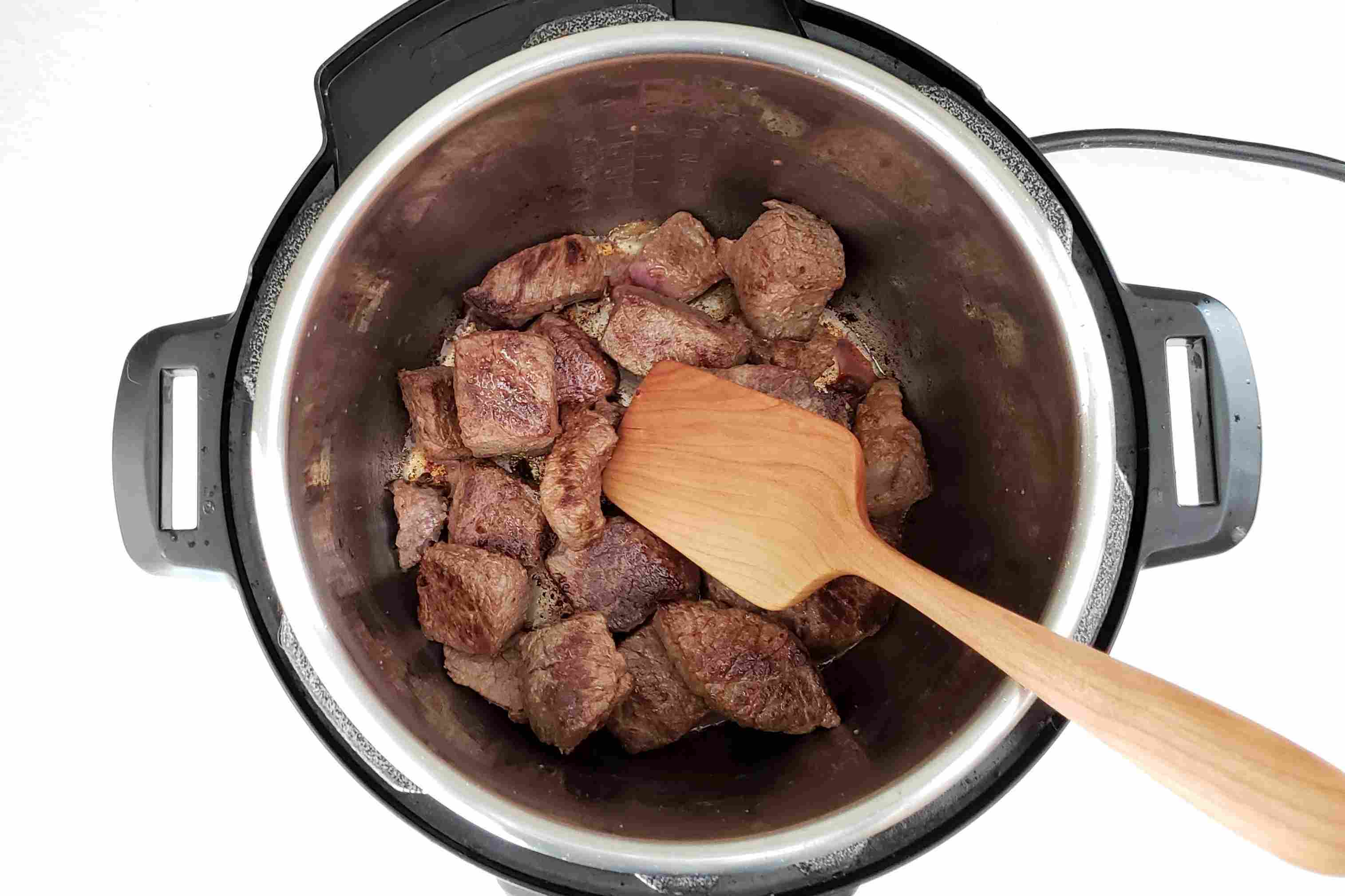 Brown the beef pieces.