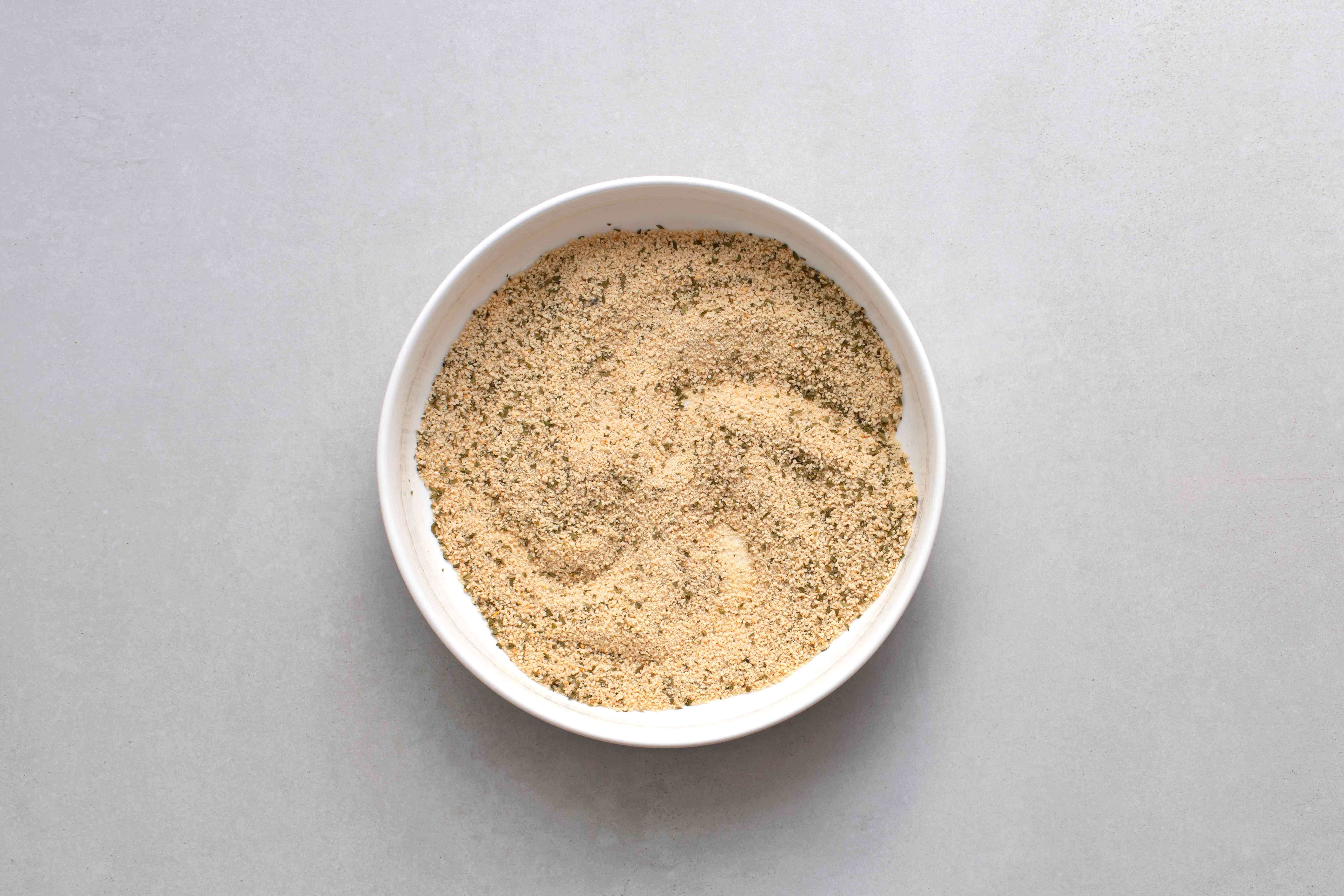Combine the breadcrumbs and parsley in a wide bowl
