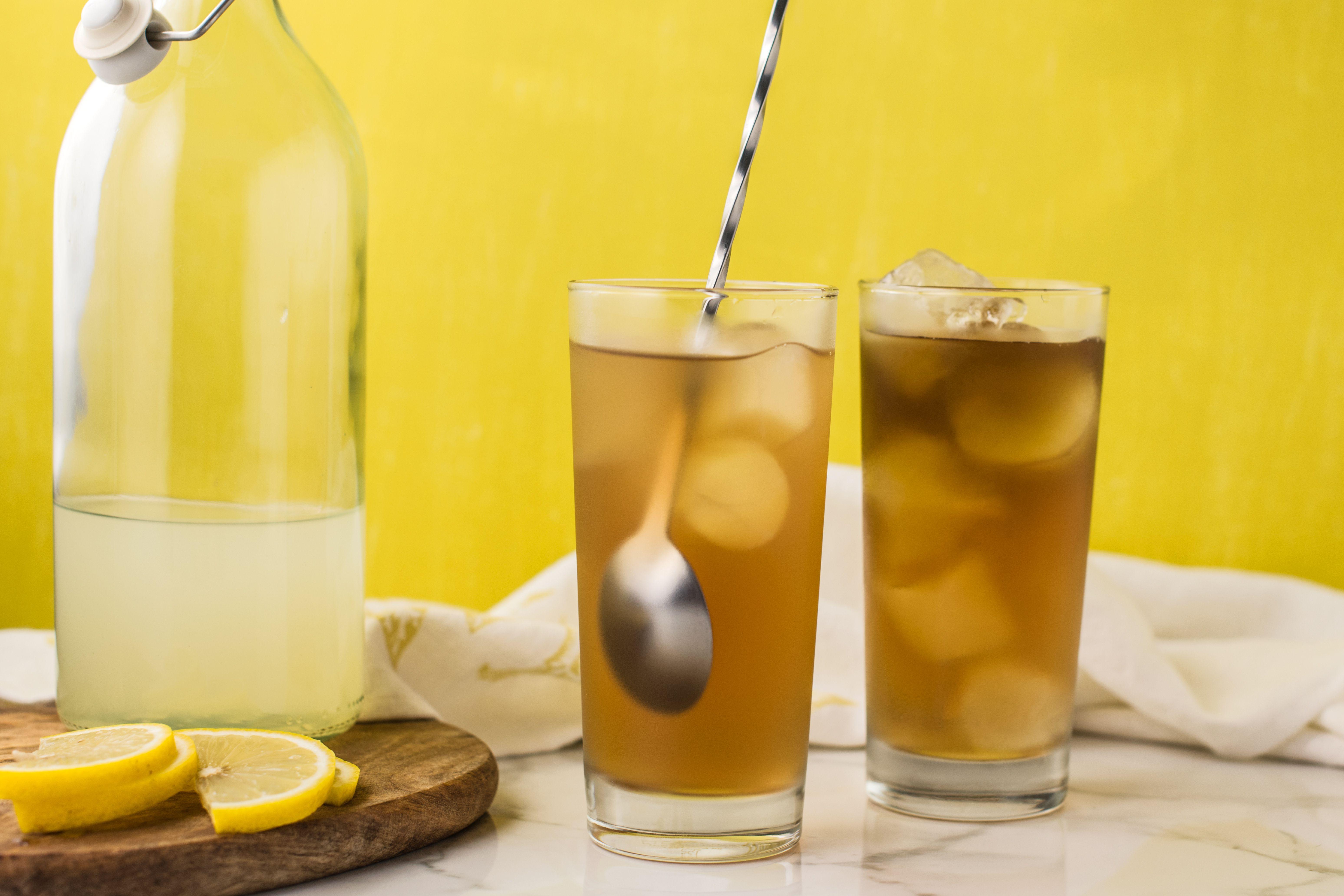 Stirring a glass of tea and lemonade
