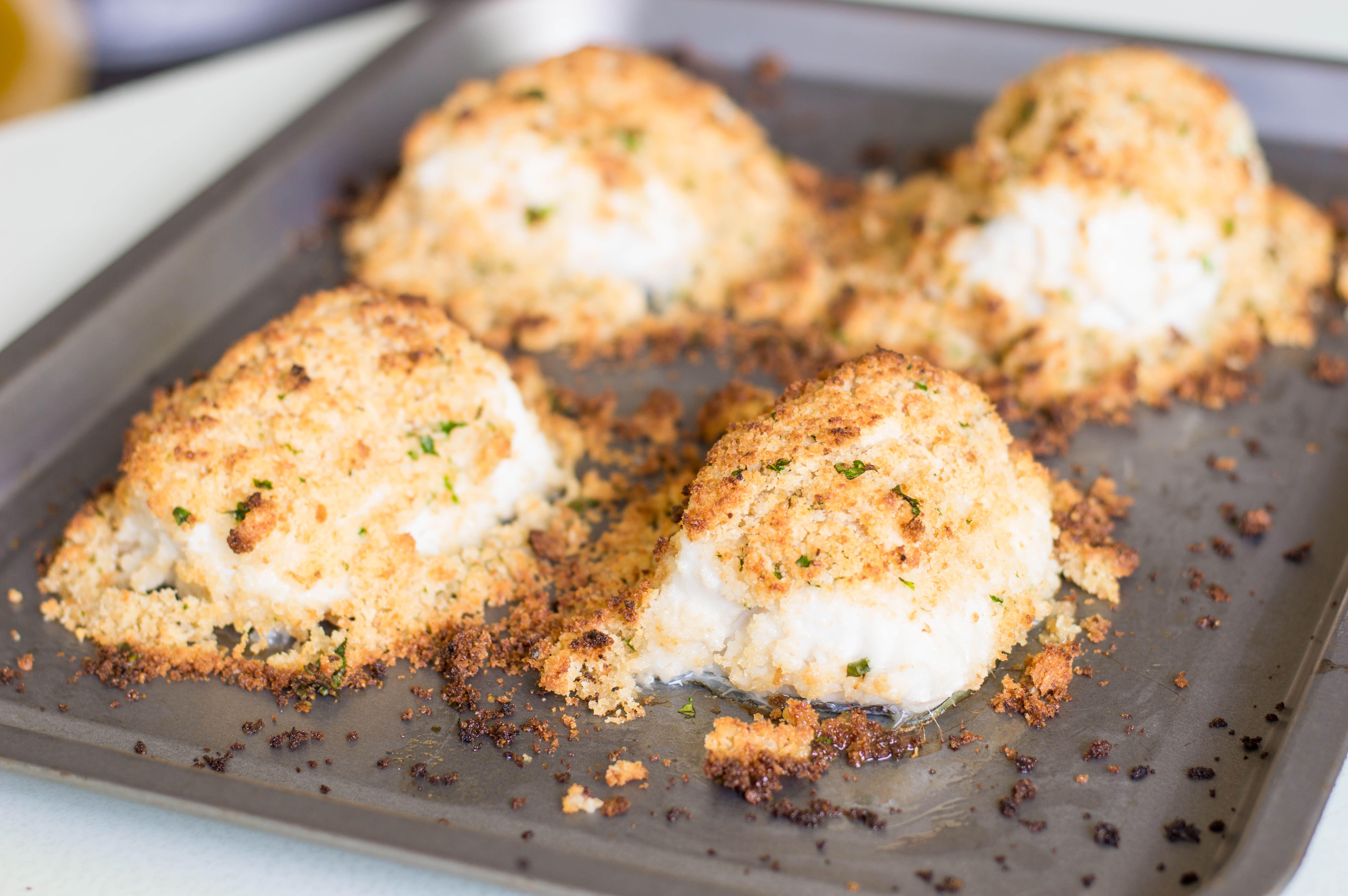 Parmesan-crusted halibut on rimmed baking sheets