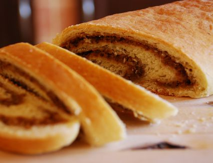 Baked roll cake with nuts filling