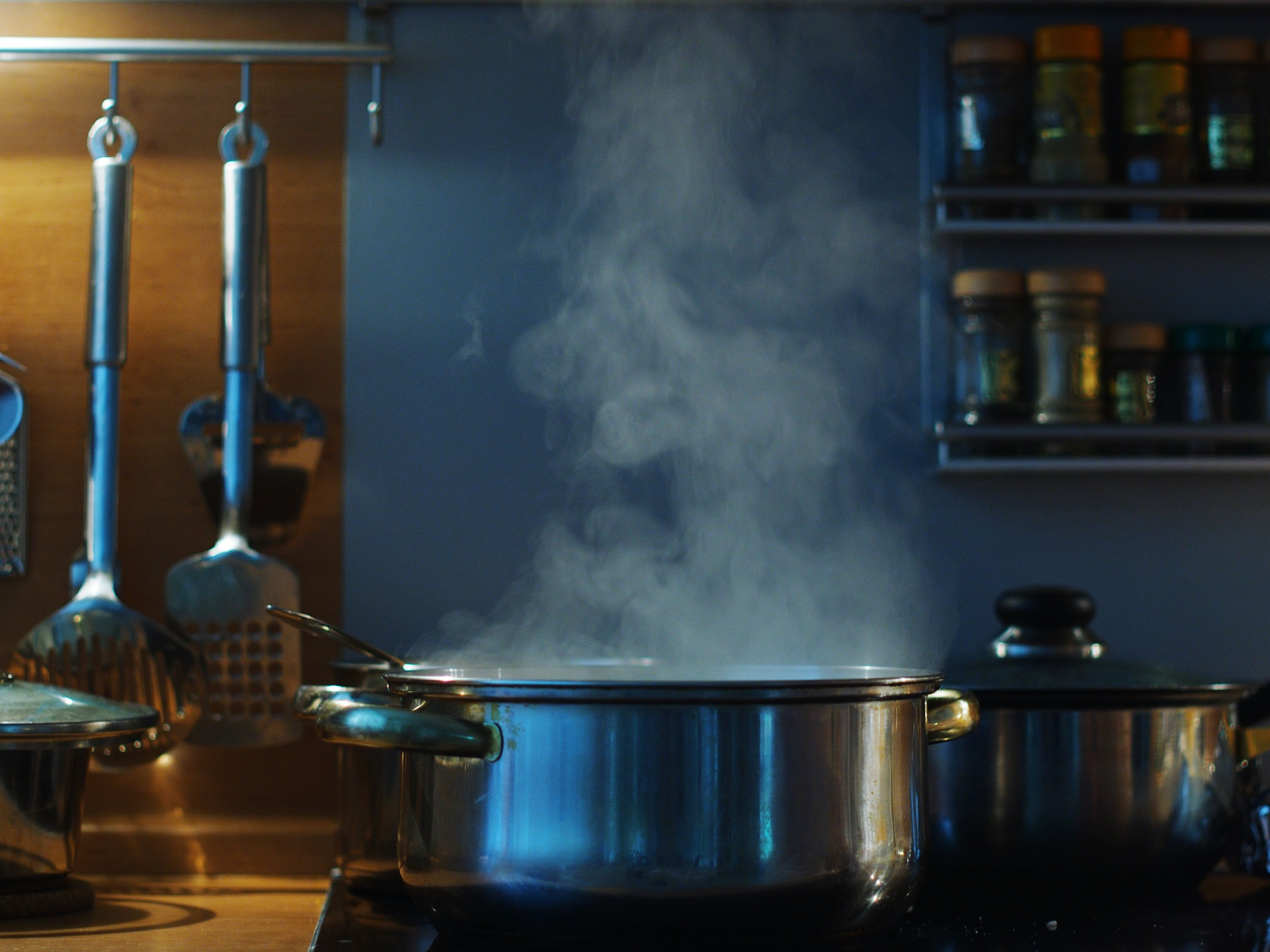 Close-Up Of Steaming Pot On Stove In Kitchen
