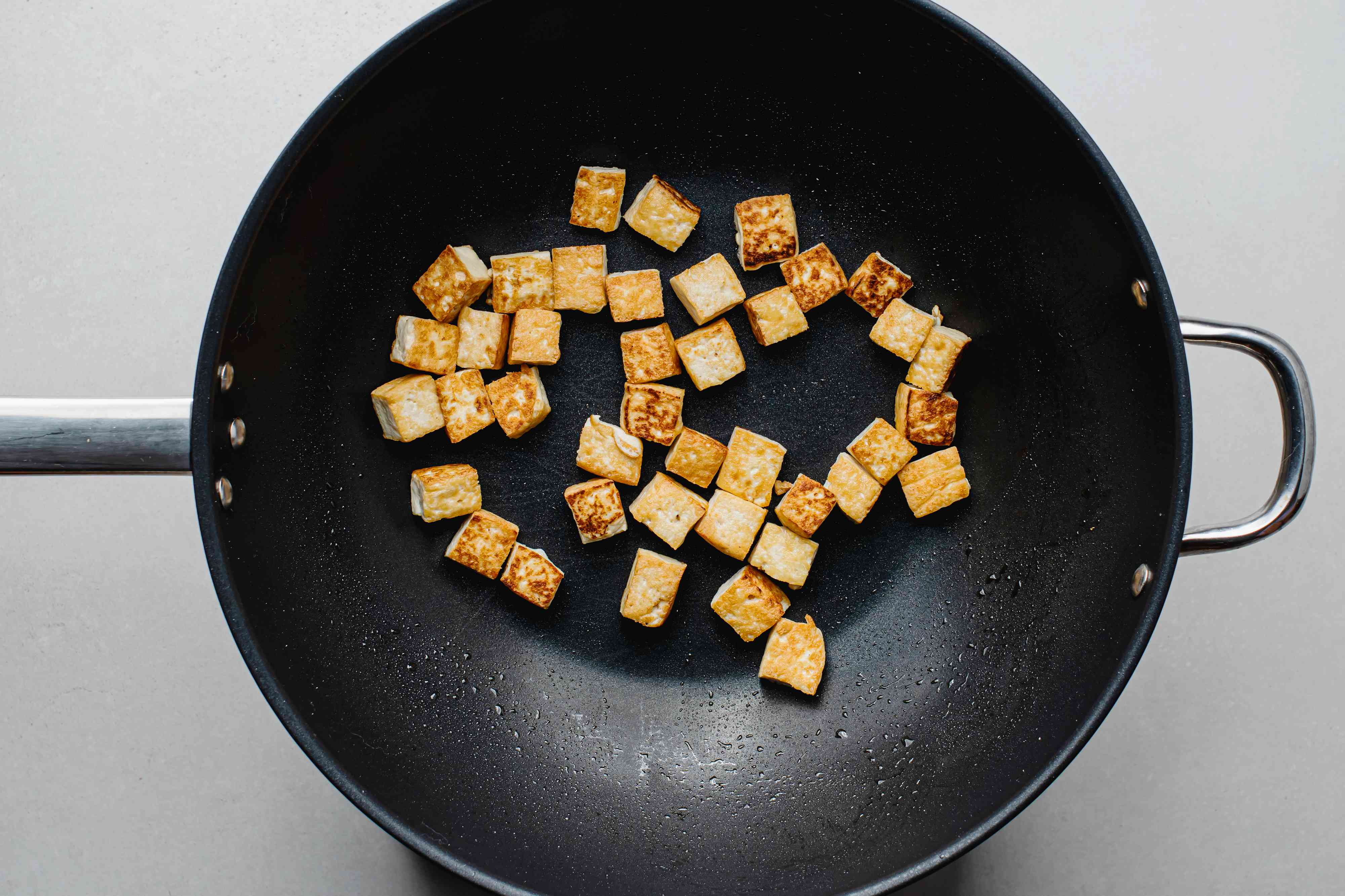 tofu cooking in a wok