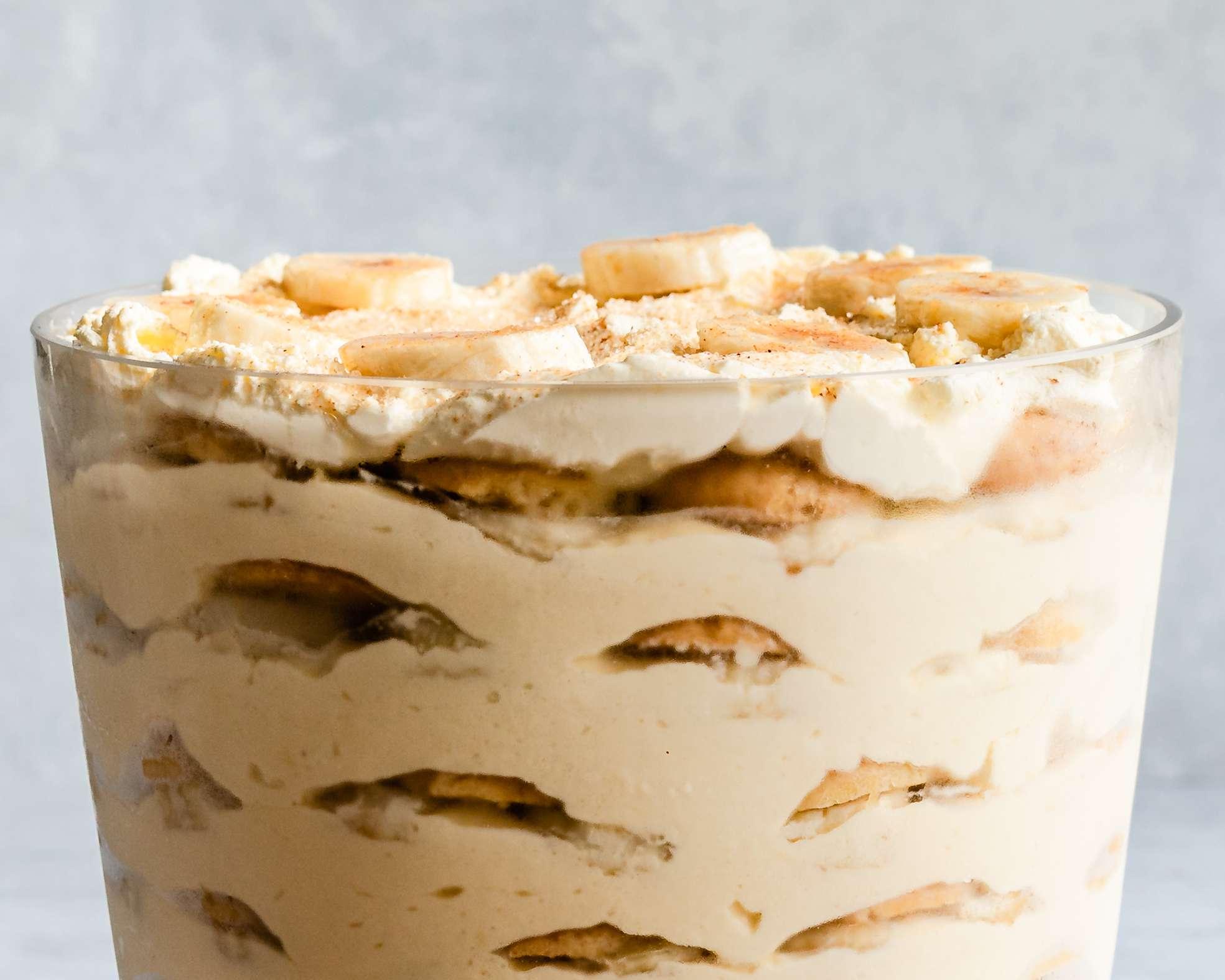 Banana pudding garnished with slices of banana and cinnamon sugar