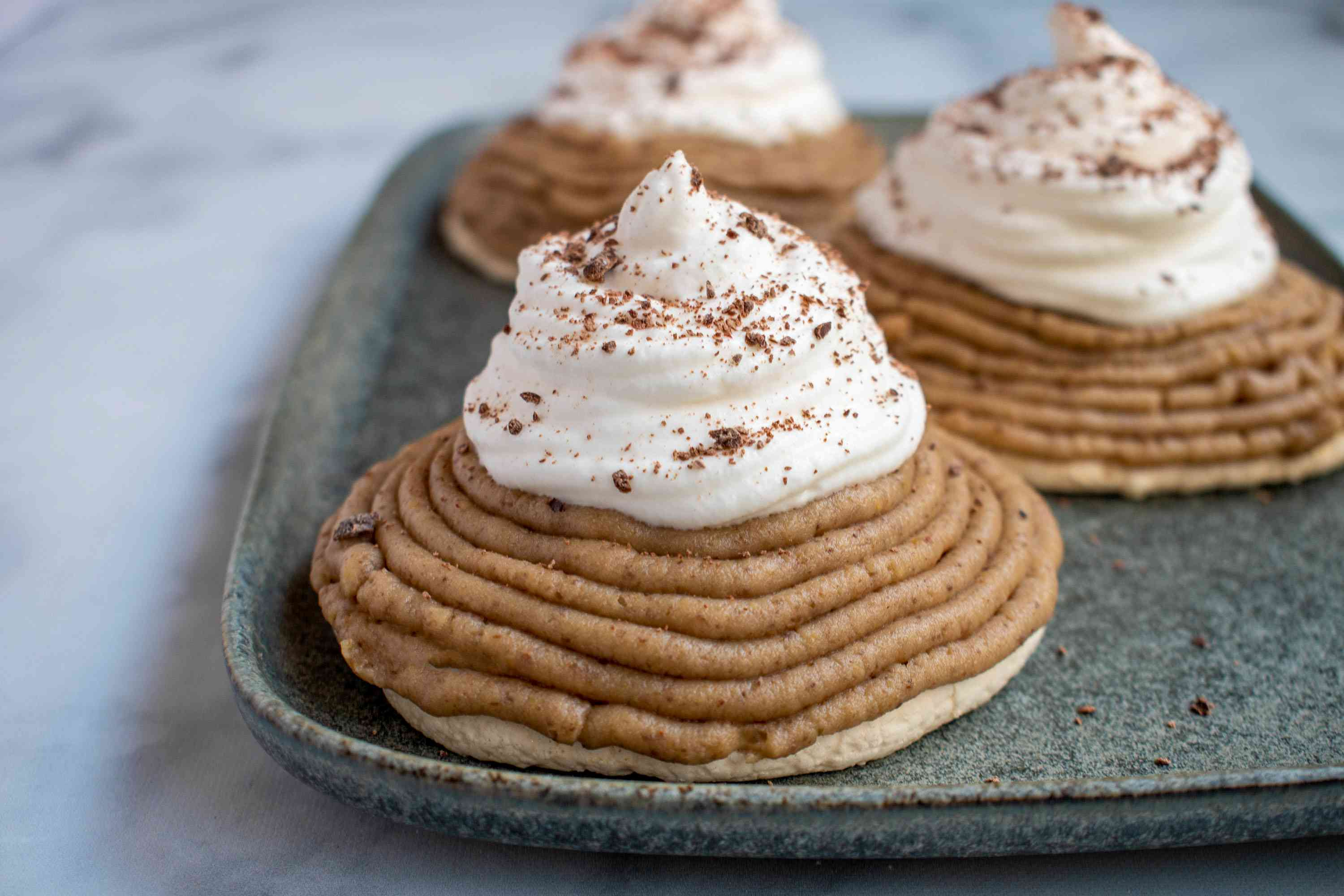 Sprinkle grated chocolate over the whipped cream on top of the chestnut puree