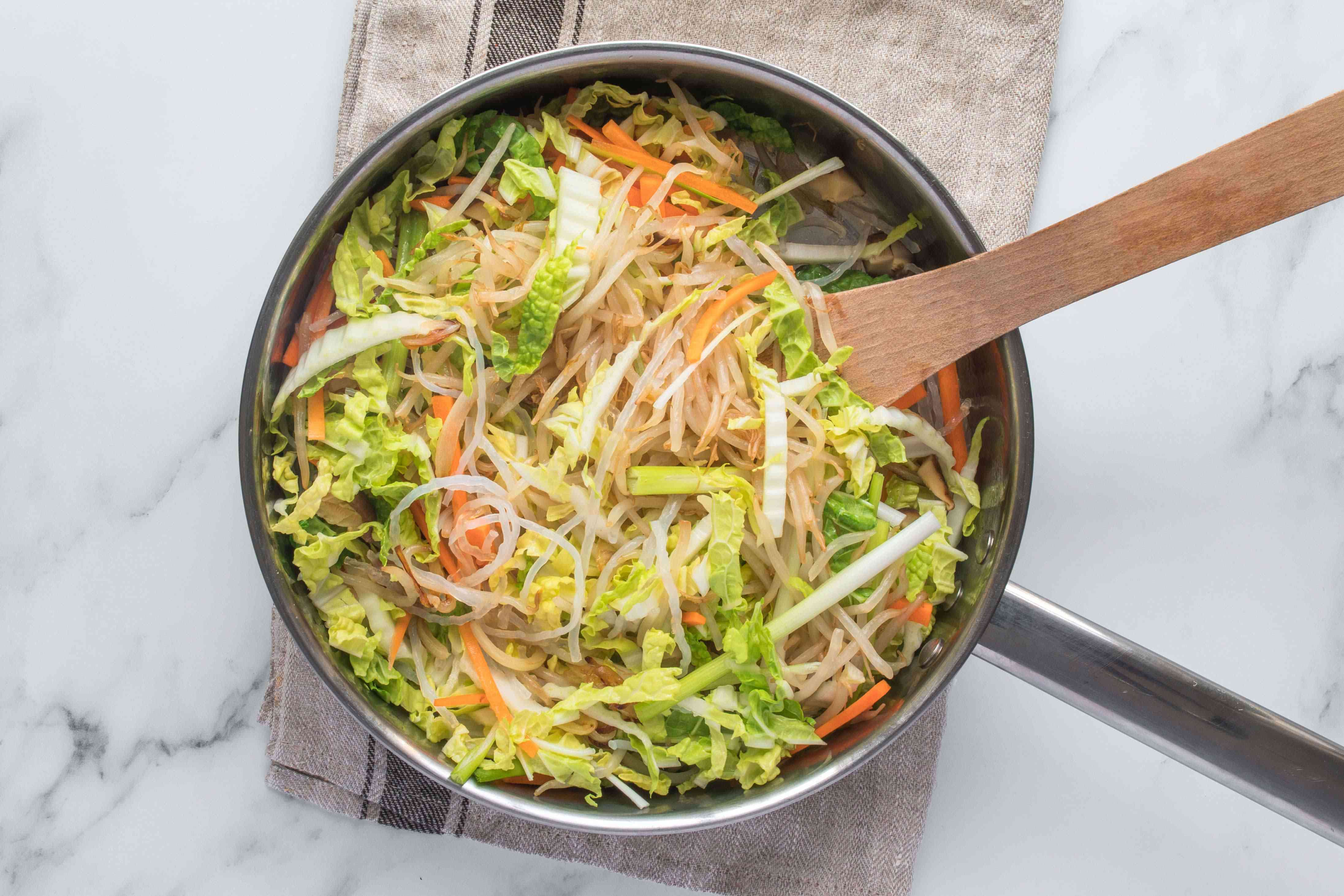 Vegetables and noodles in a pan