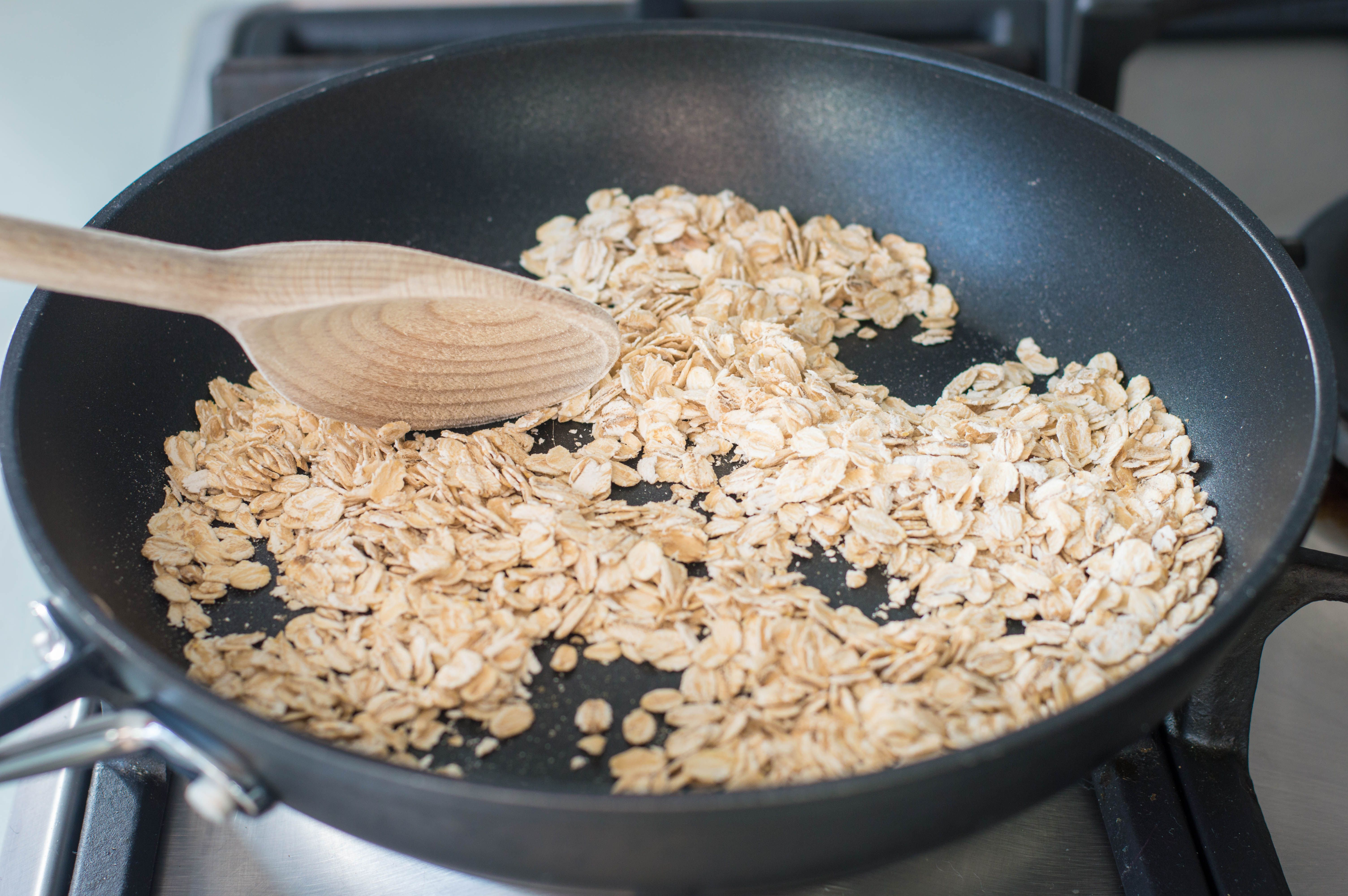 Oats toasting in a skillet