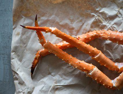 alaskan crab legs on paper