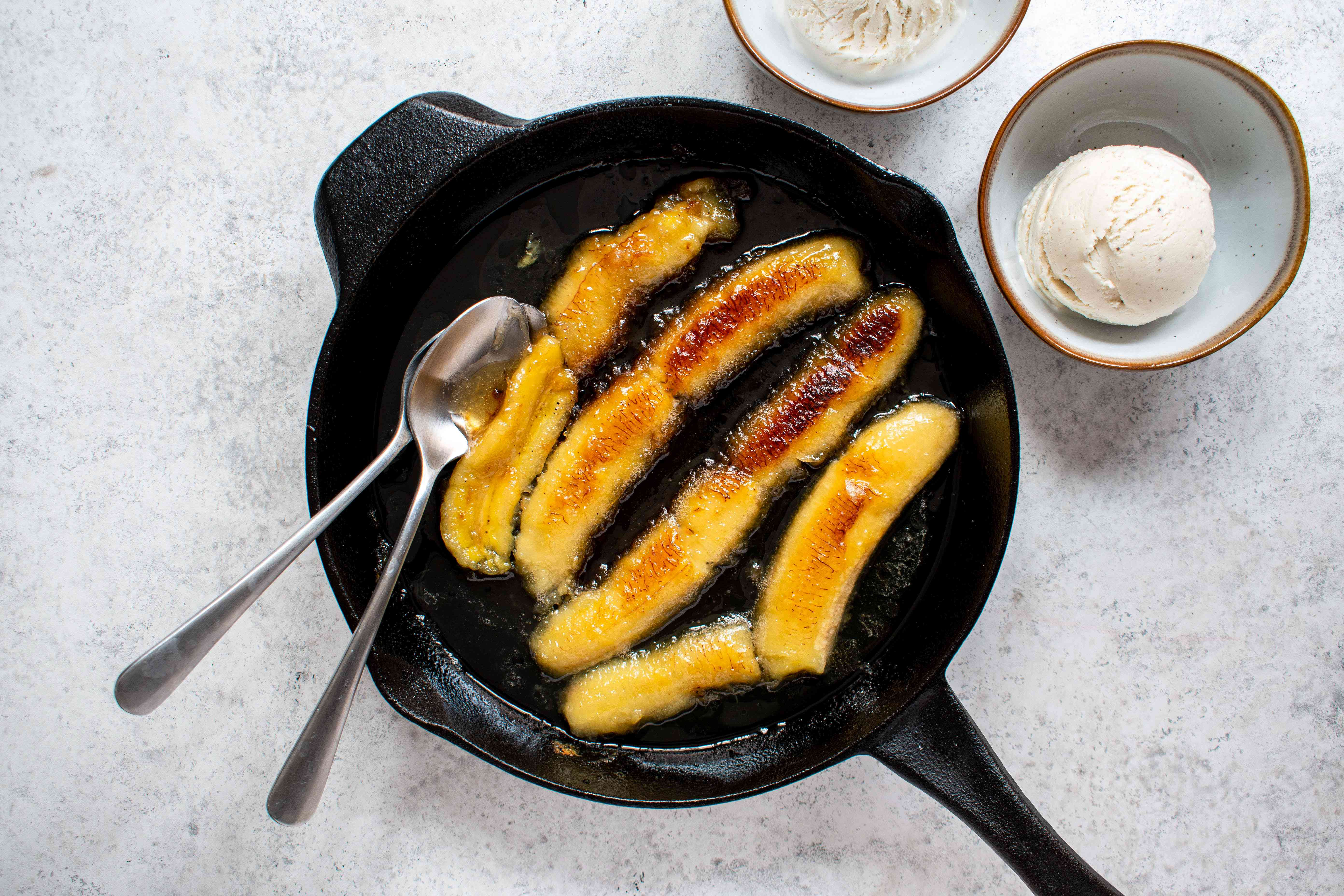 Easy Bananas Flambe, Sprinkle with lime juice and serve with vanilla ice cream