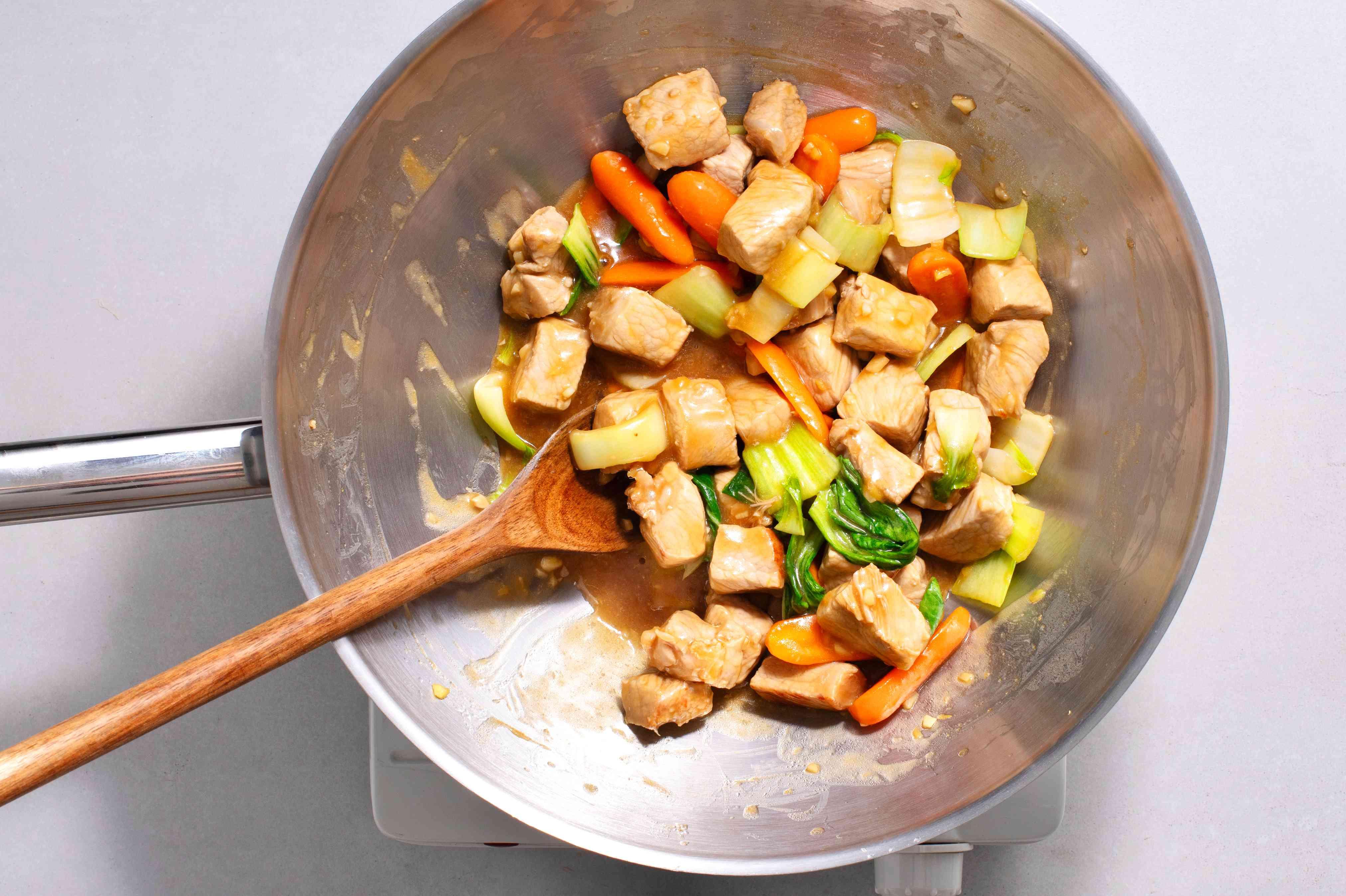 Chinese Orange Pork Chop Stir-fry cooking in a wok