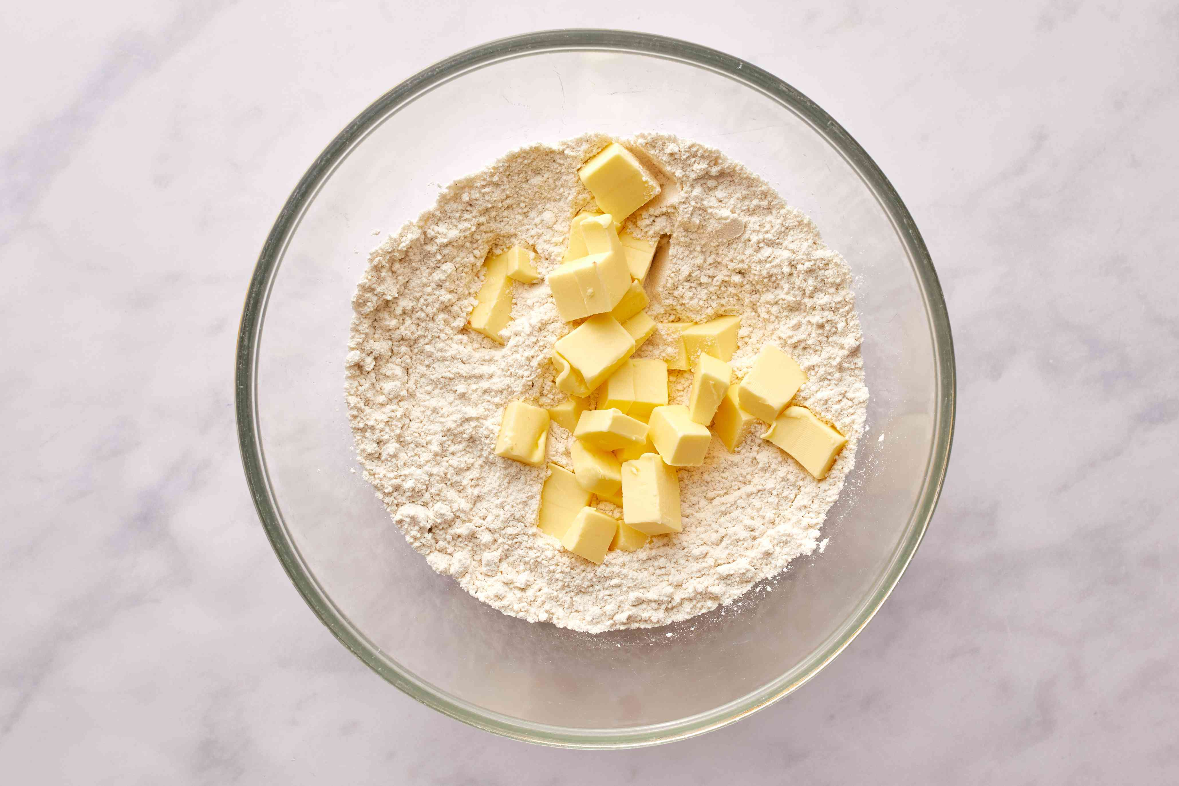 In a large bowl, combine the flour, sugar, and salt, with butter