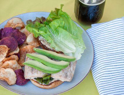 mahi-mahi burger with avocado, roasted poblano and cumin mayo