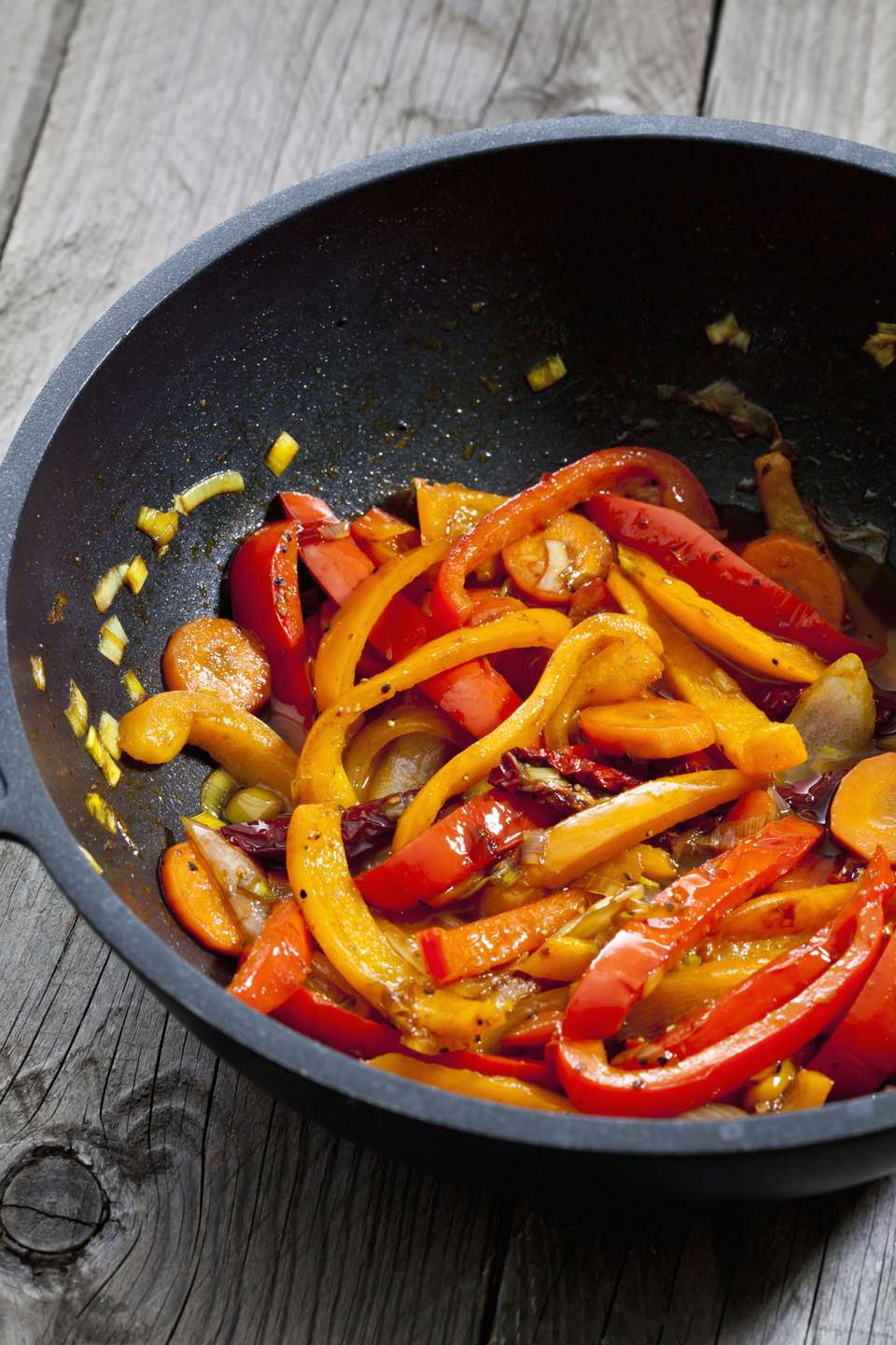 Sauteed bell pepper in a fajita pan