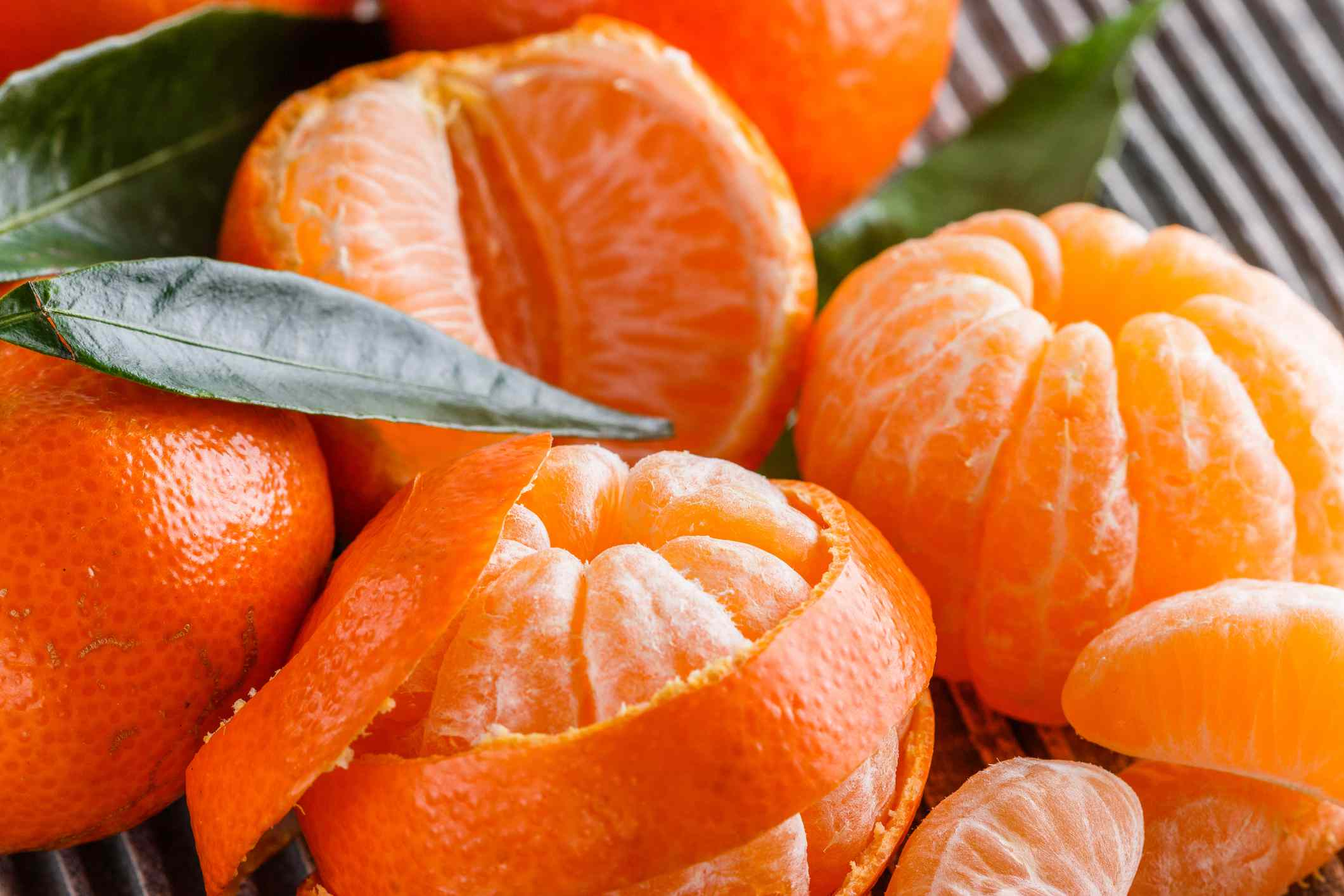 juicy mandarin on a gray wooden rustic background