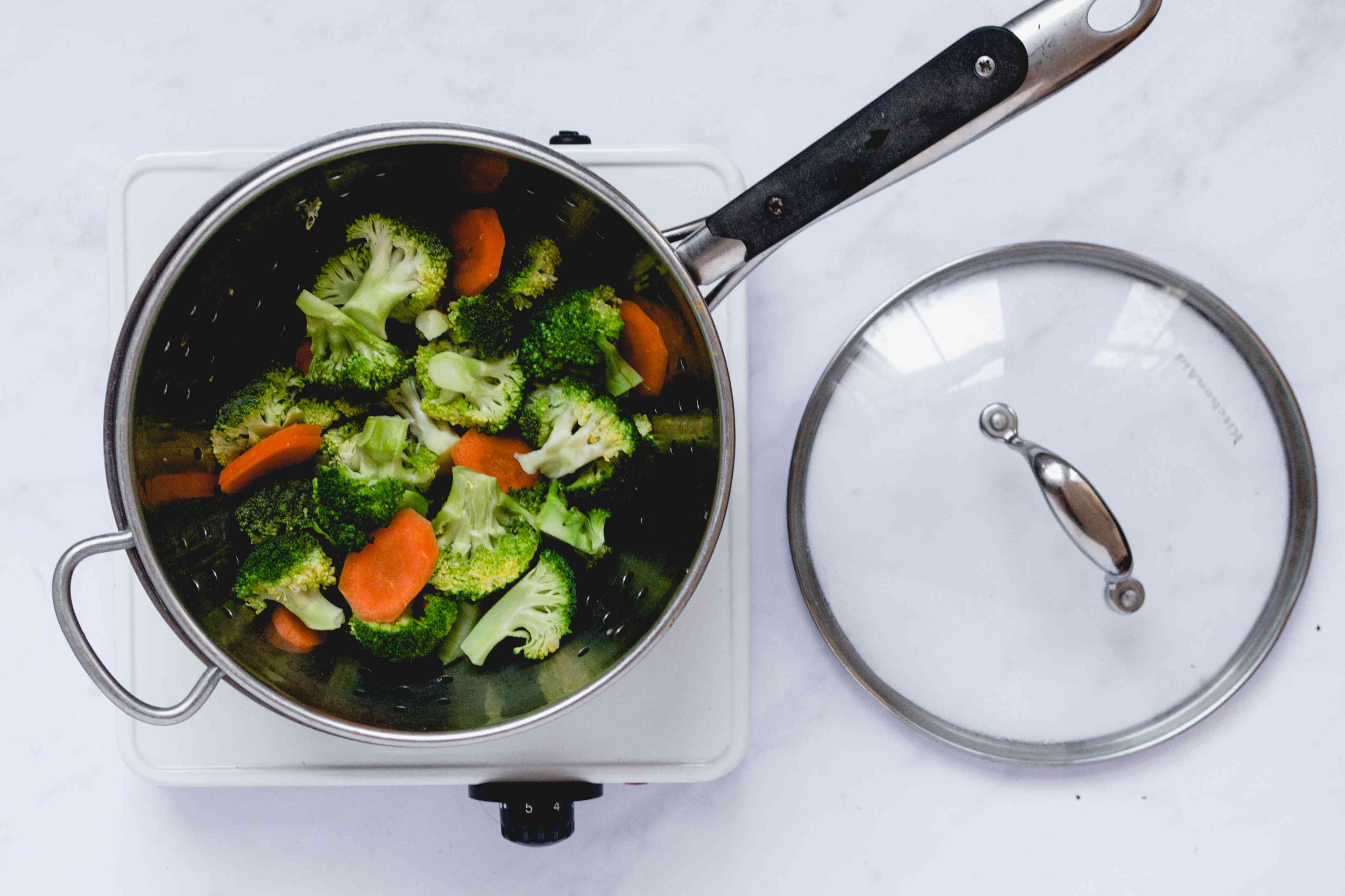 steam the broccoli florets and sliced carrots