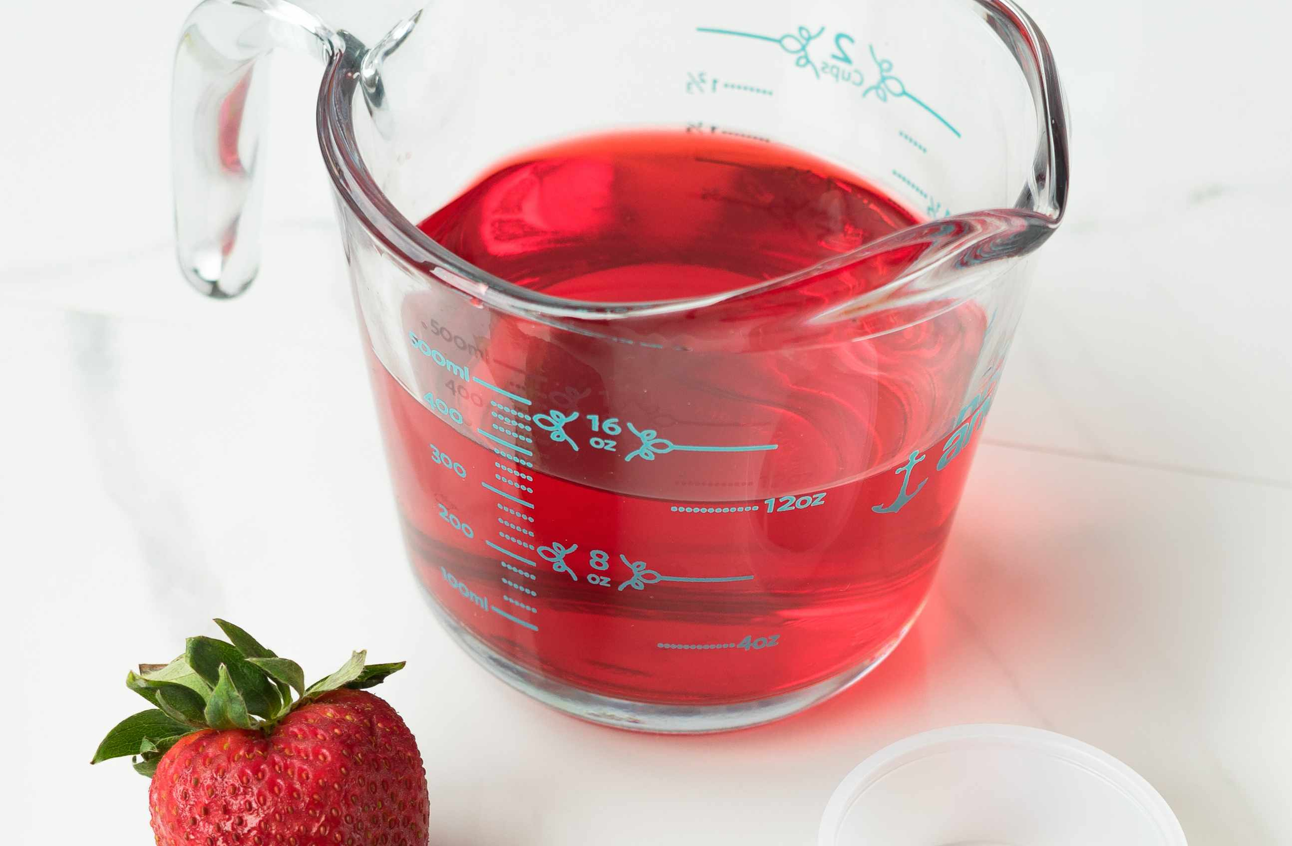 Gelatin and boiling water in a measuring cup