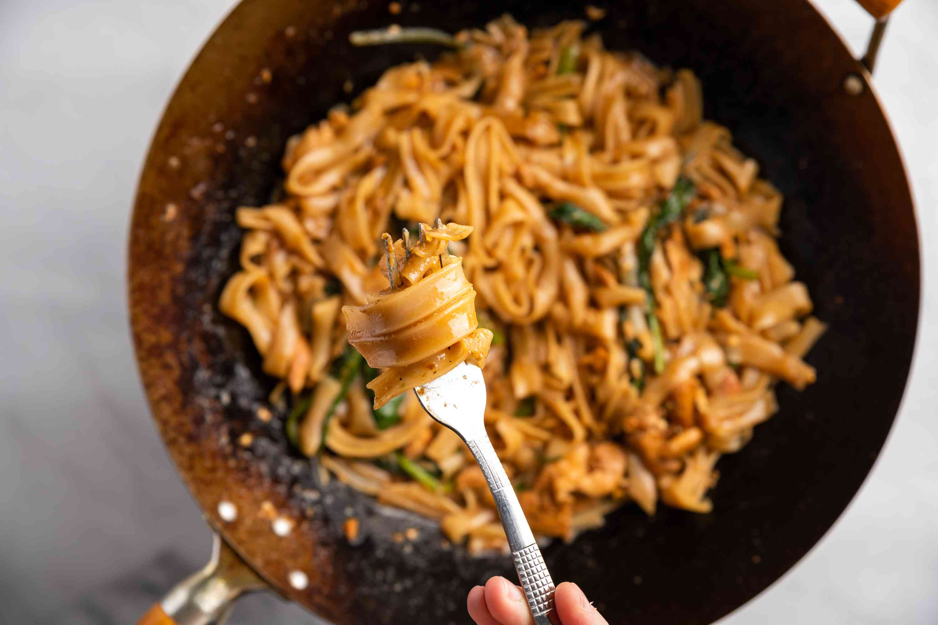 Chicken Pad See Ew (Broad Rice Noodles Fried With Soy Sauce) in a wok