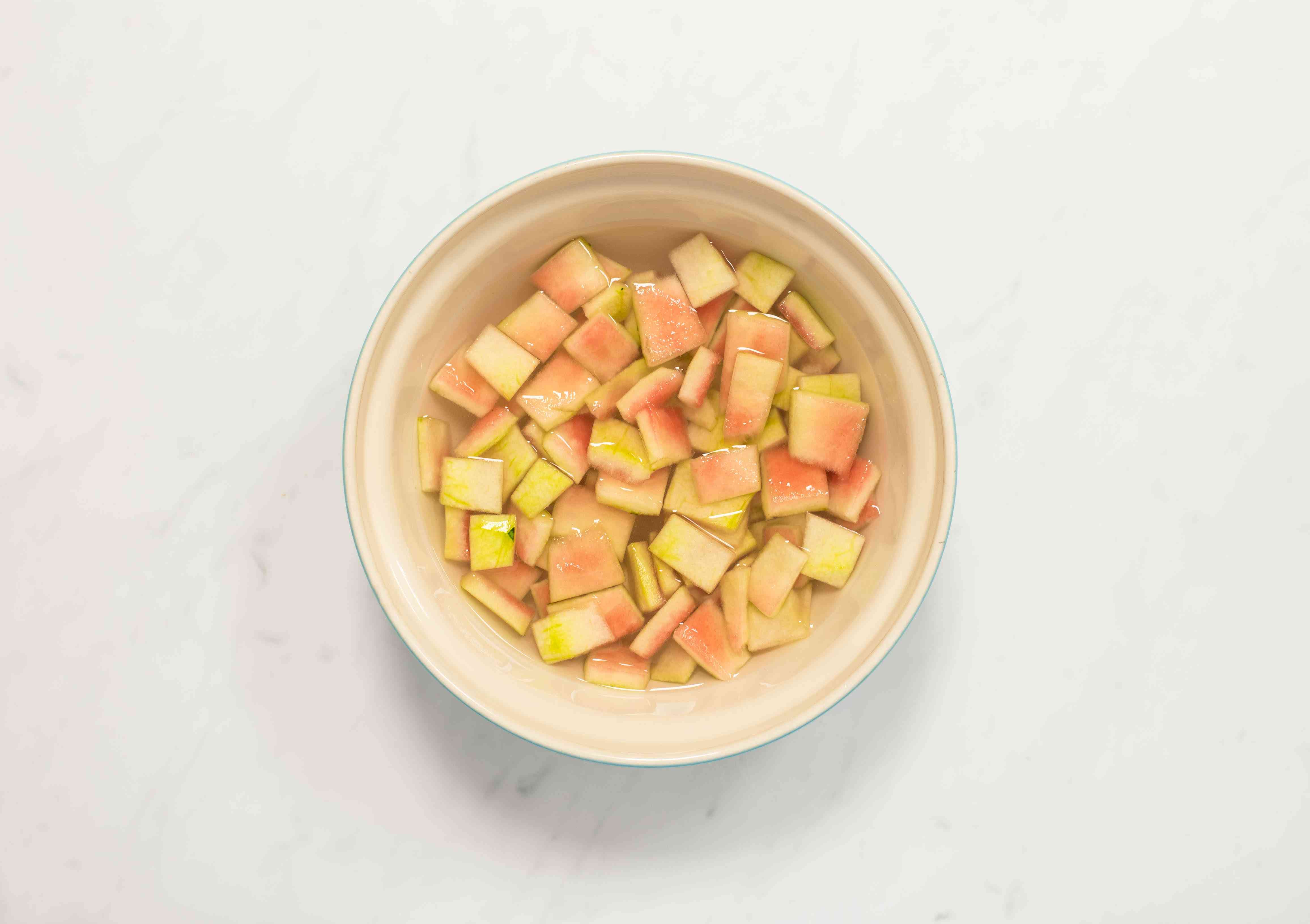 Watermelon rind in salt and water in a container
