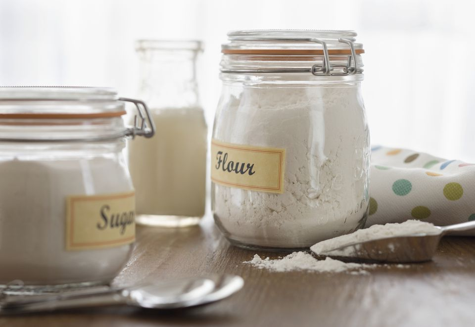 flour and sugar stored in sealed mason jars