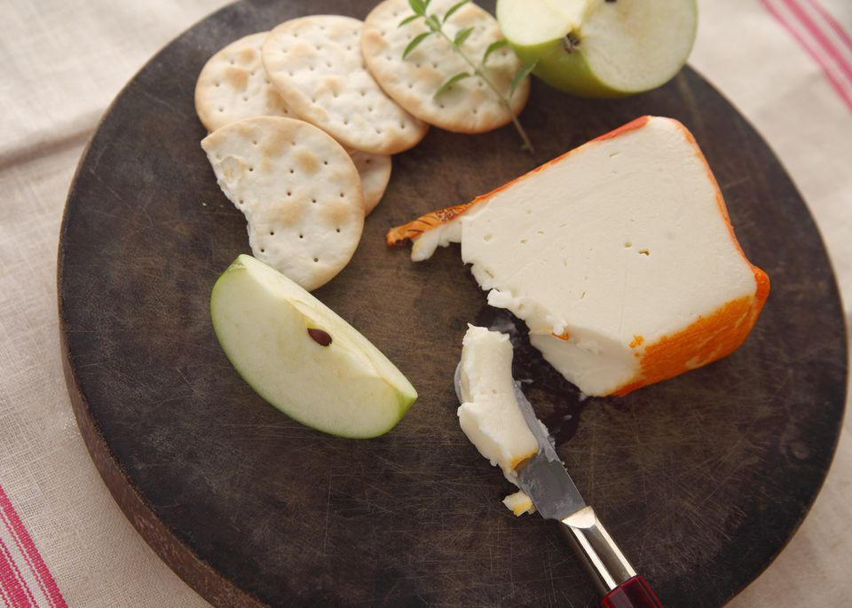 High Angle View Of Crackers And Cheese On Cutting Board