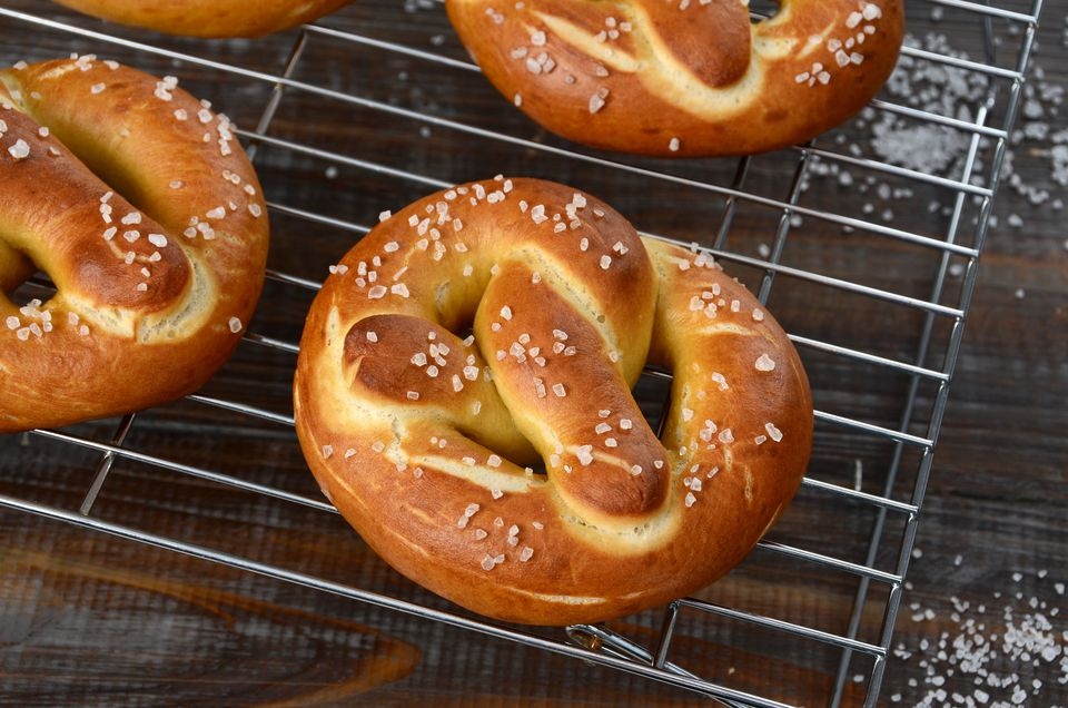 Soft pretzels dusted with salt on a baking rack