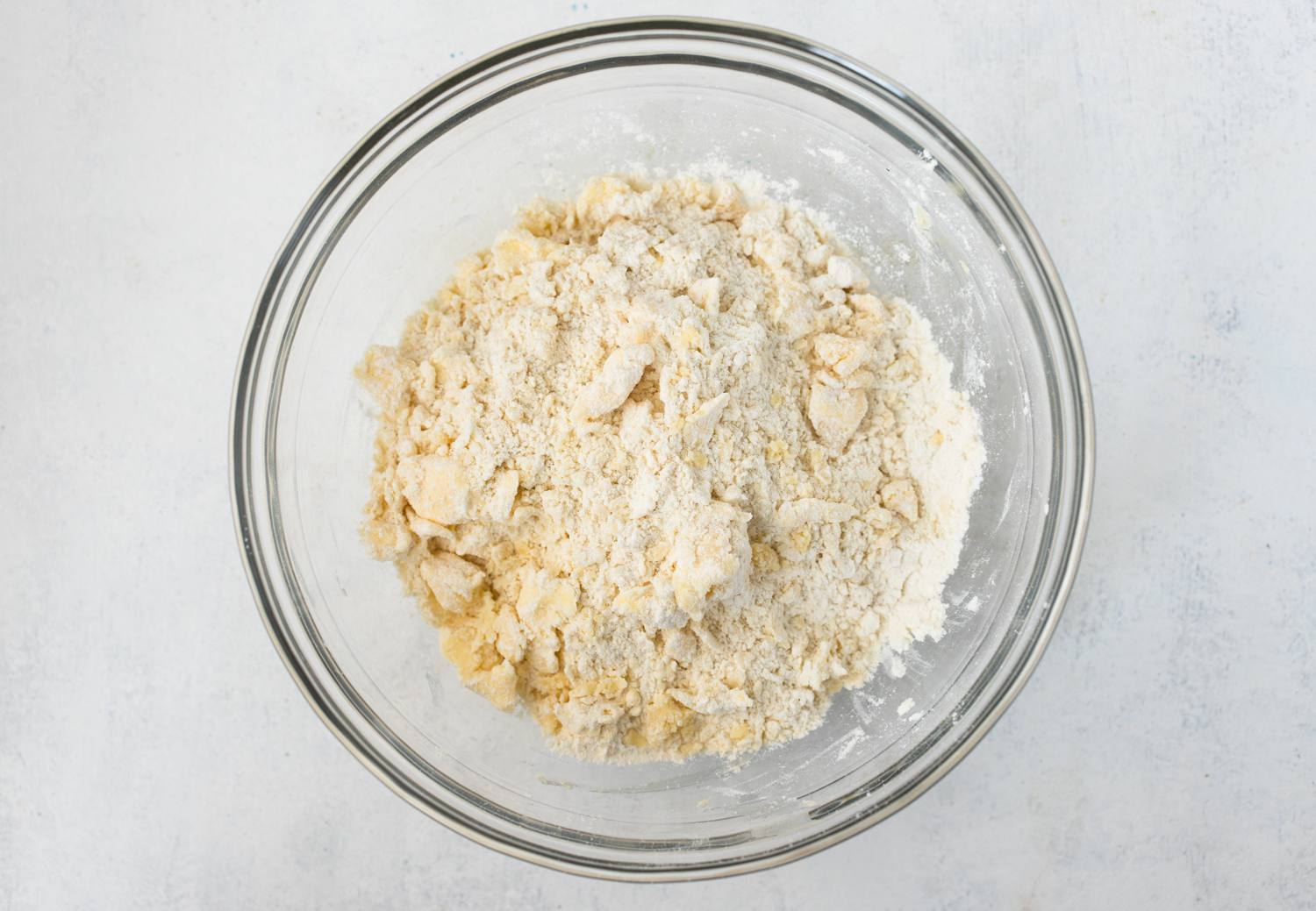 Butter is rubbed into the flour mixture