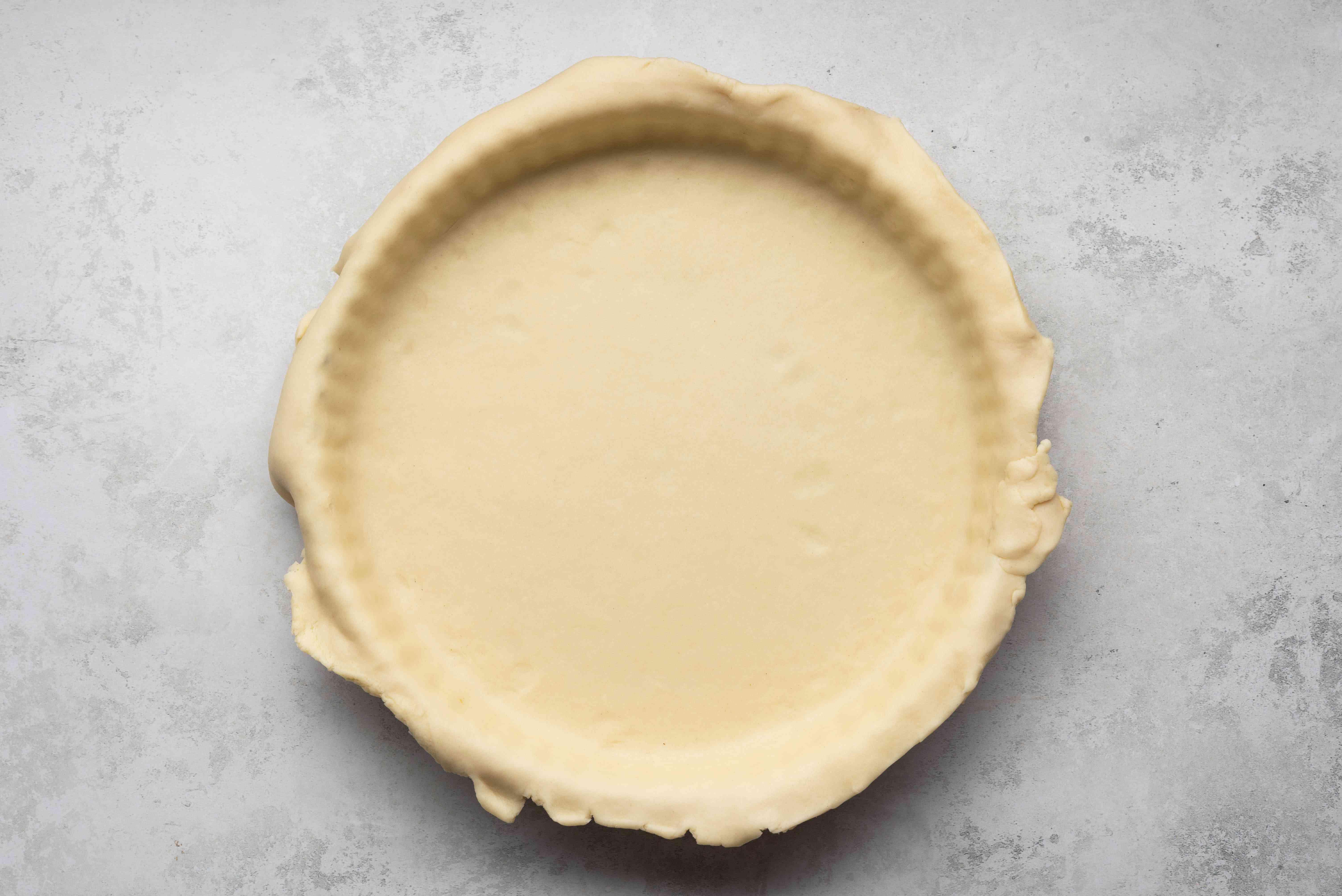 dough in a tarte pan