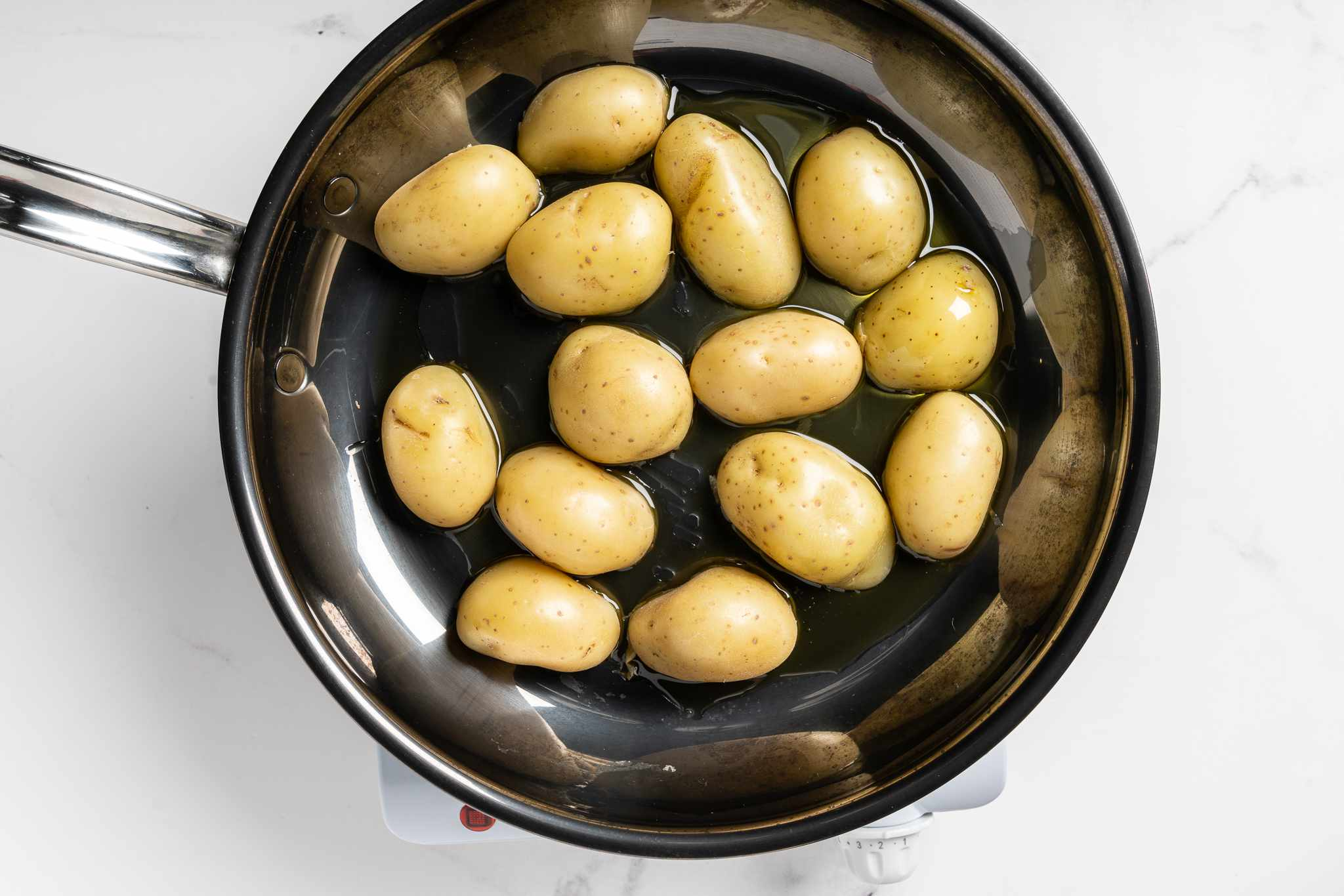 potatoes and oil in a skillet