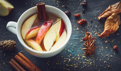 Apple cider in a mug with cinnamon