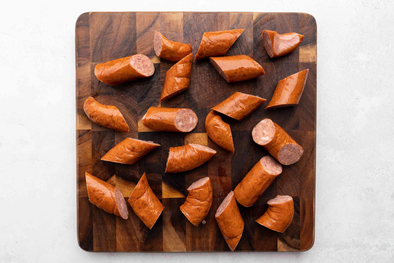 sliced kielbasa on a cutting board