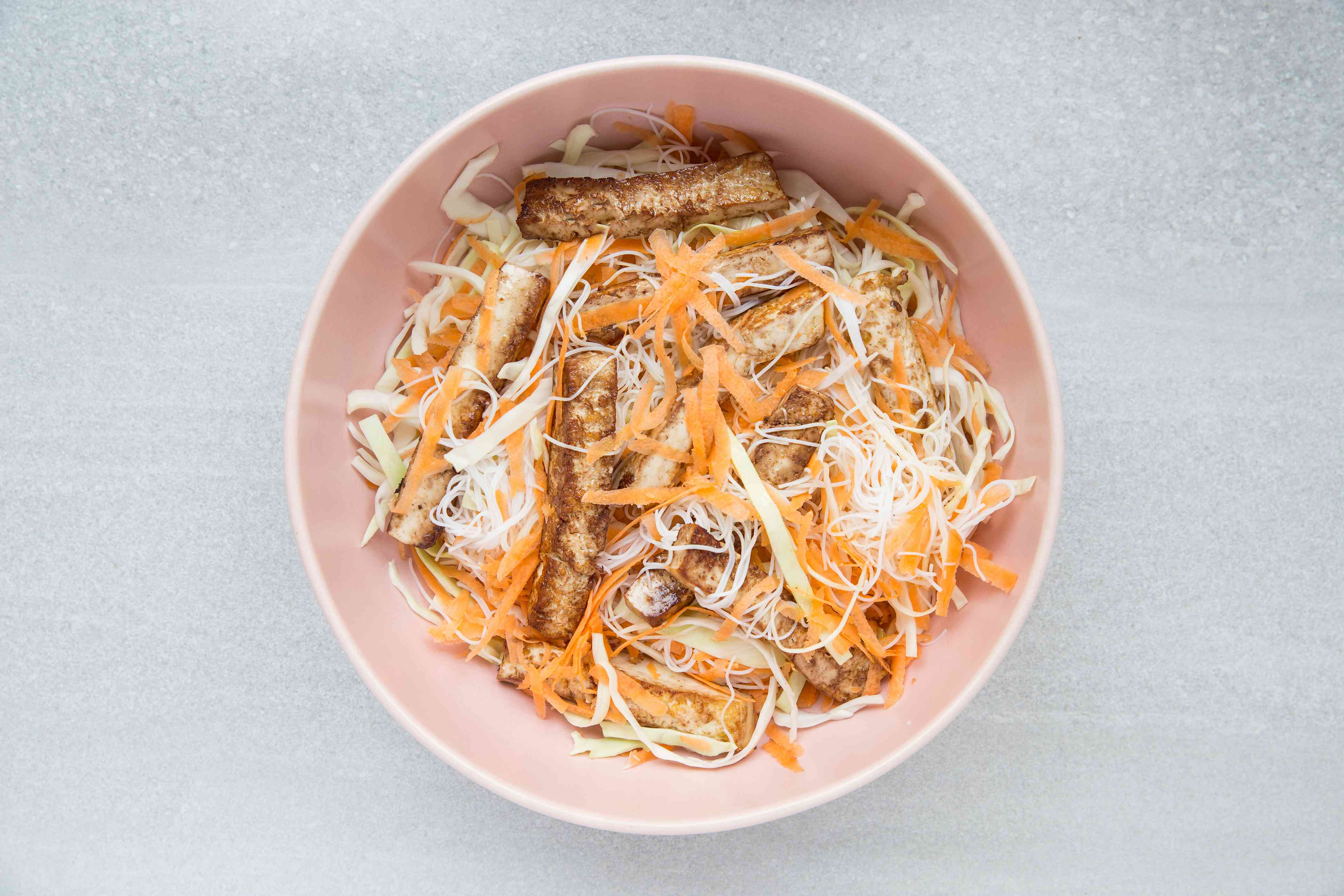 toss together the tofu with the cabbage, carrots, and noodles