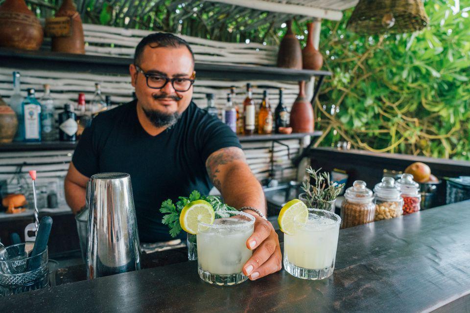 Guy serving margaritas at an open air bar