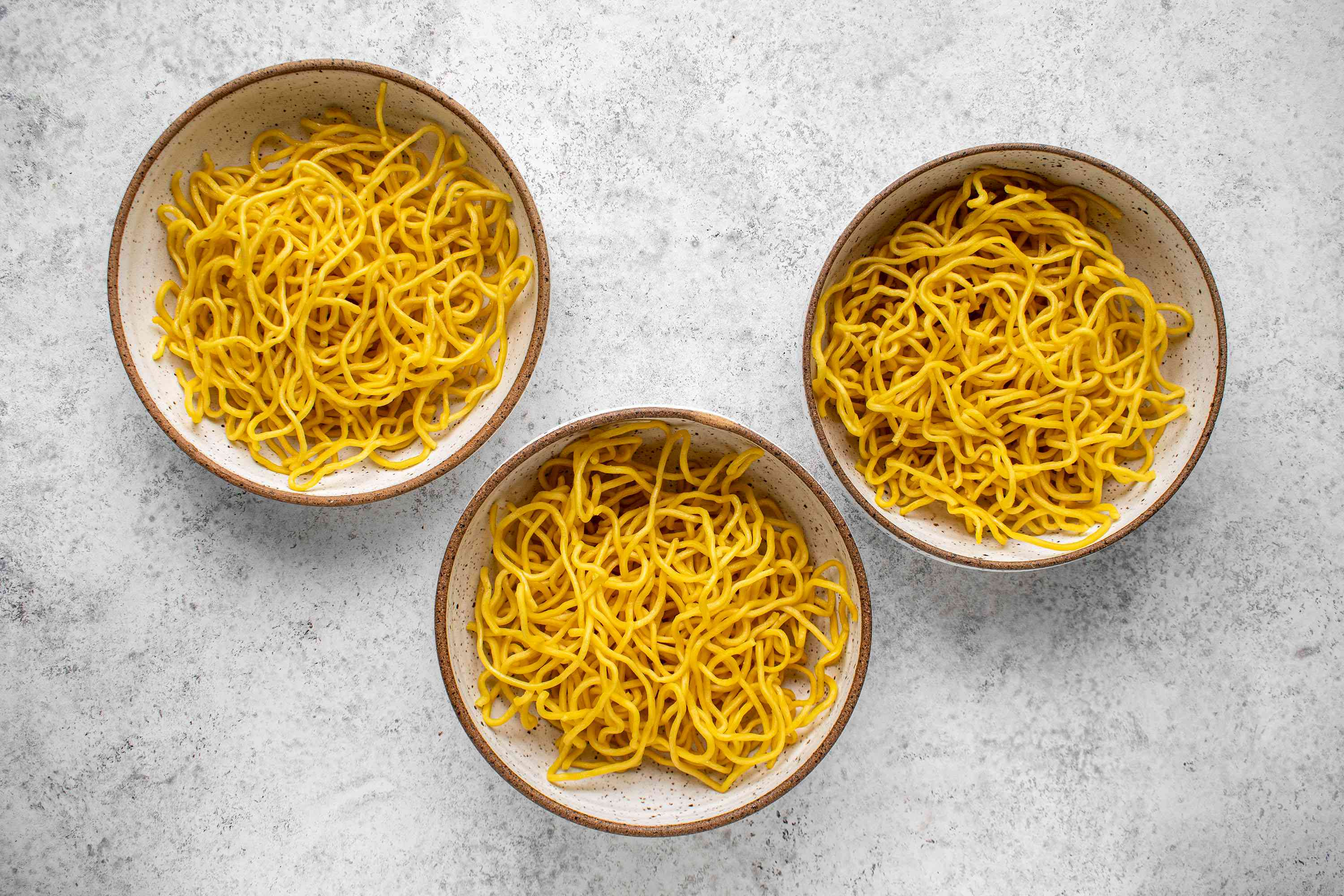 Divide the noodles among three bowls