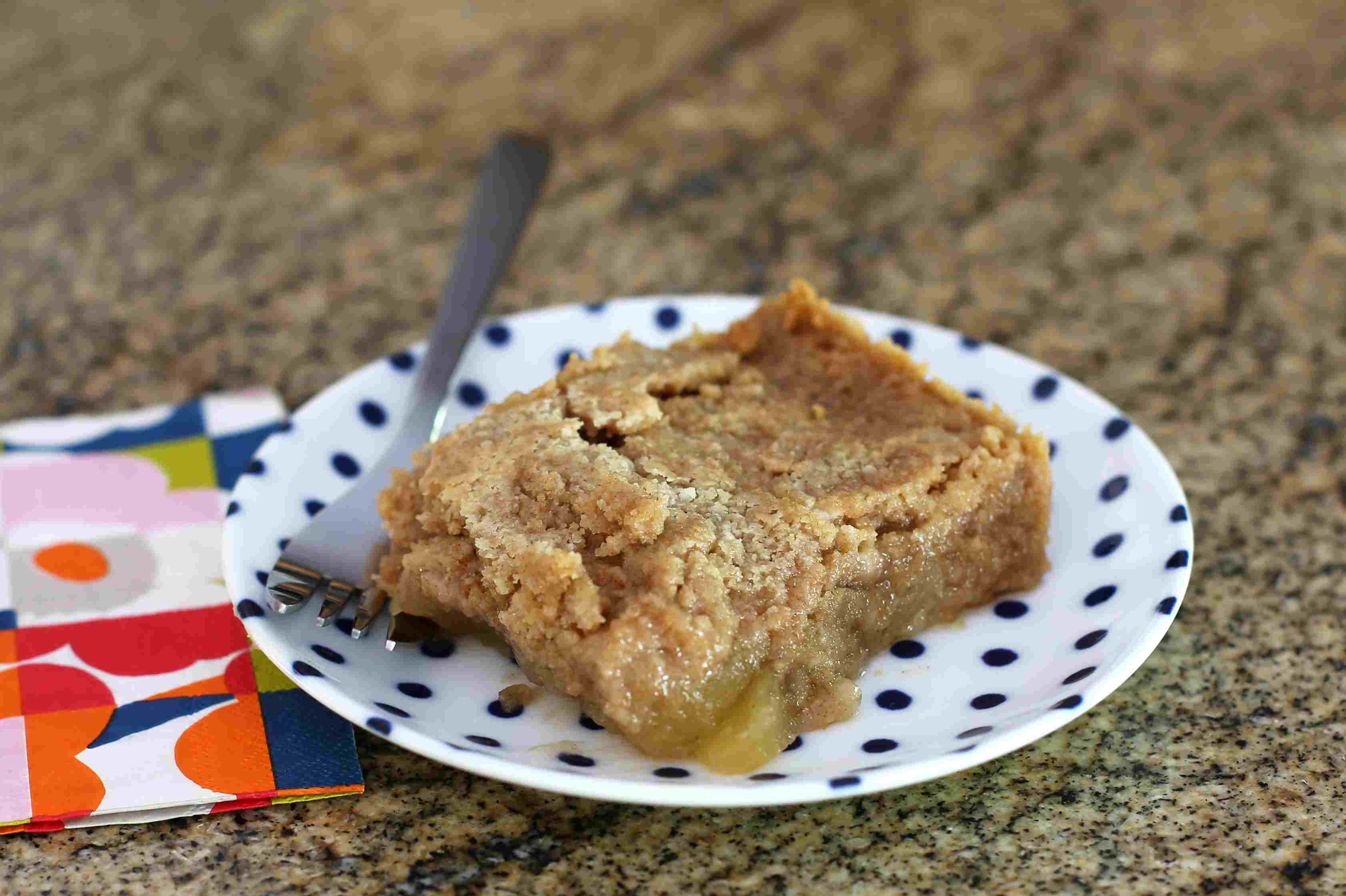 Apple dump cake on a plate with a fork