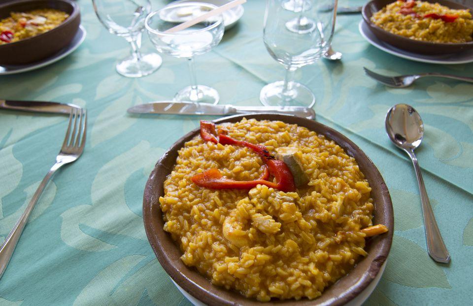 Paella rice meal on plate in restaurant, Havana, Cuba